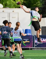 Devin Copeland goes up but can't catch the pass as the NFL, Tennessee Titans, and Special Olympics host a flag football game on Wednesday.