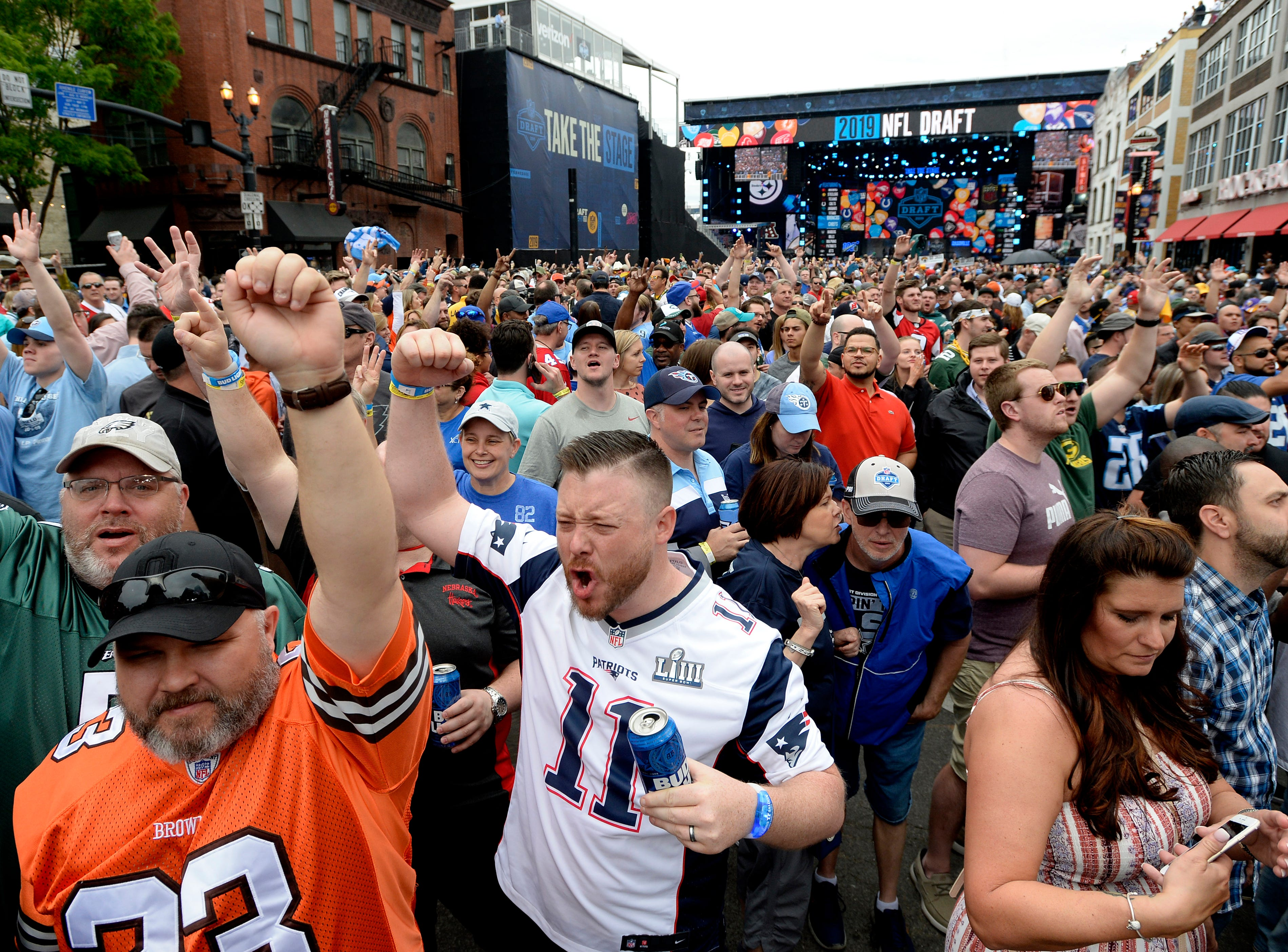 Fans cheer on Lower Broadway as they wait for the start of the NFL Draft on Thursday, April 25, 2019, in Nashville, Tenn.