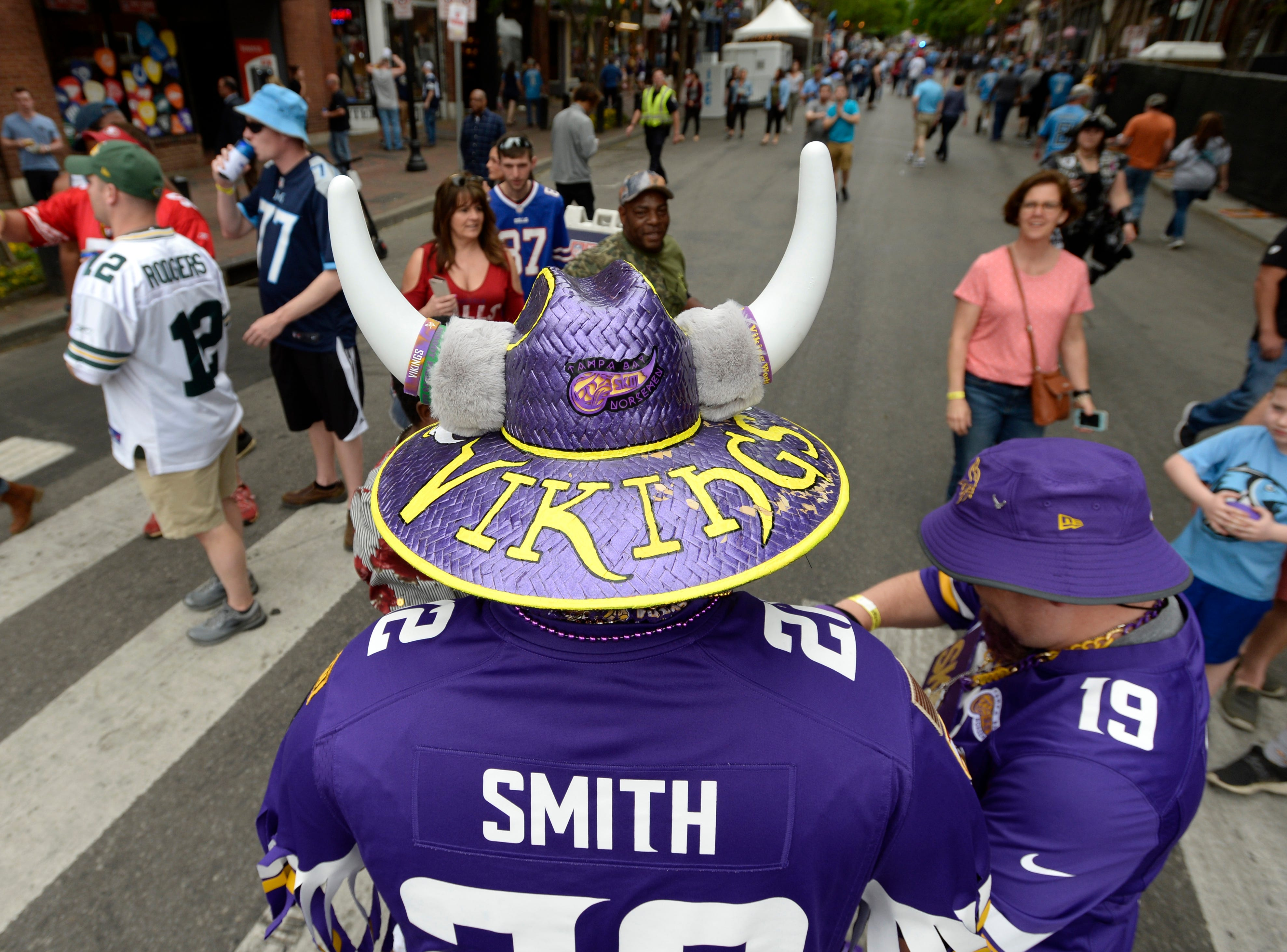 A Minnesota Vikings fan checks out Lower Broadway before the start of the first round of the NFL Draft  Thursday, April 25, 2019 in Nashville, Tenn.