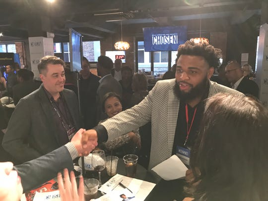 NFL Draft prospect Christian Wilkins mingles with executives from The Procter & Gamble Company at a networking event at Nashville Underground in downtown Nashville on Wednesday, April 24, 2019.