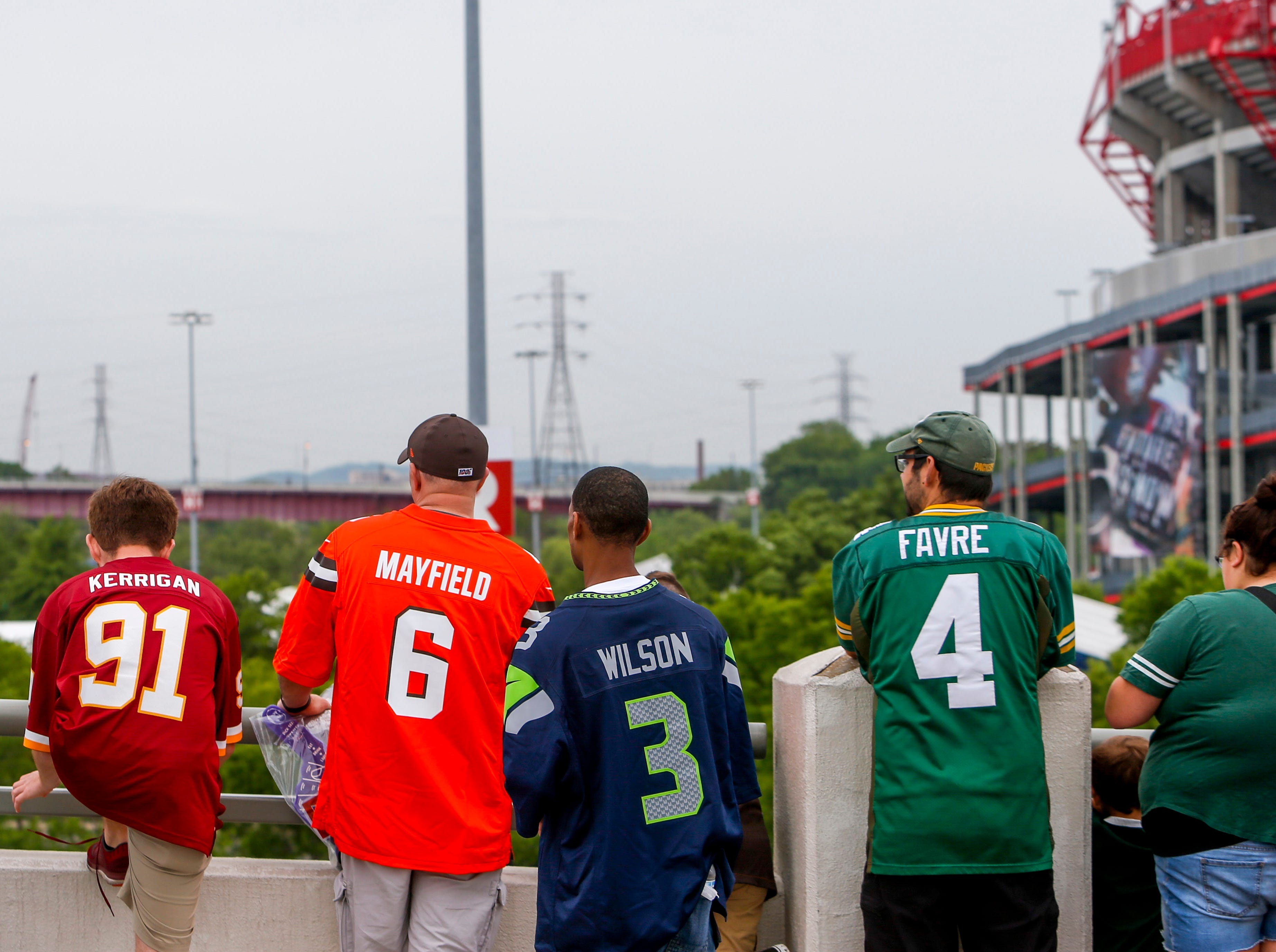 Fans of many teams line up on the railing of the bridge during the NFL Draft Experience at Nissan Stadium in Nashville, Tenn., on Thursday, April 25, 2019.