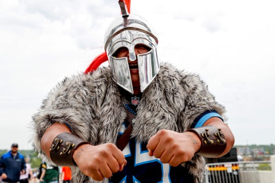 Onesimo Villarreal gnashes his teeth and gives a roar dressed in full Titan uniform during the NFL Draft Experience at Nissan Stadium in Nashville, Tenn., on Thursday, April 25, 2019.