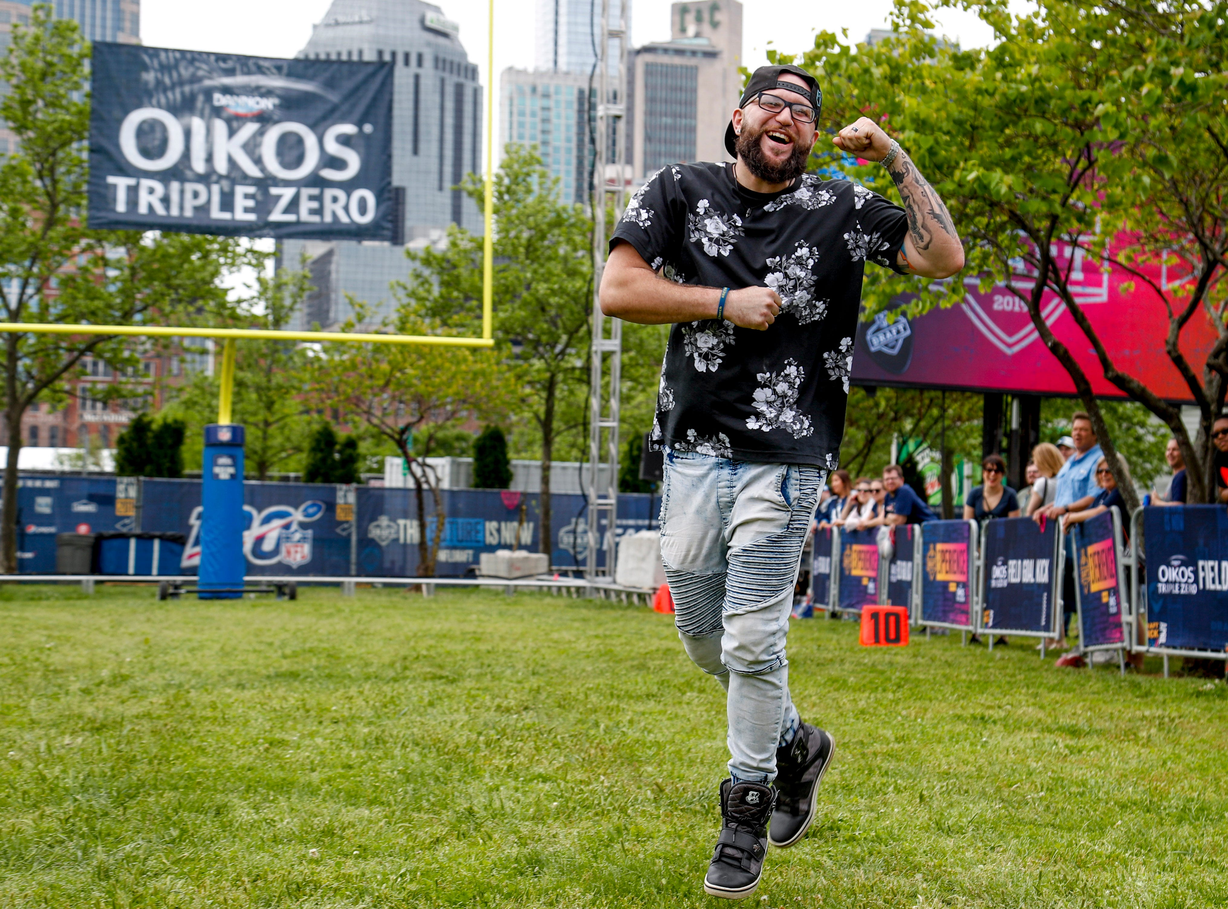 A fan jumps around in joyful disappointment after kicking a ball that rolled on the ground during the NFL Draft Experience at Nissan Stadium in Nashville, Tenn., on Thursday, April 25, 2019.