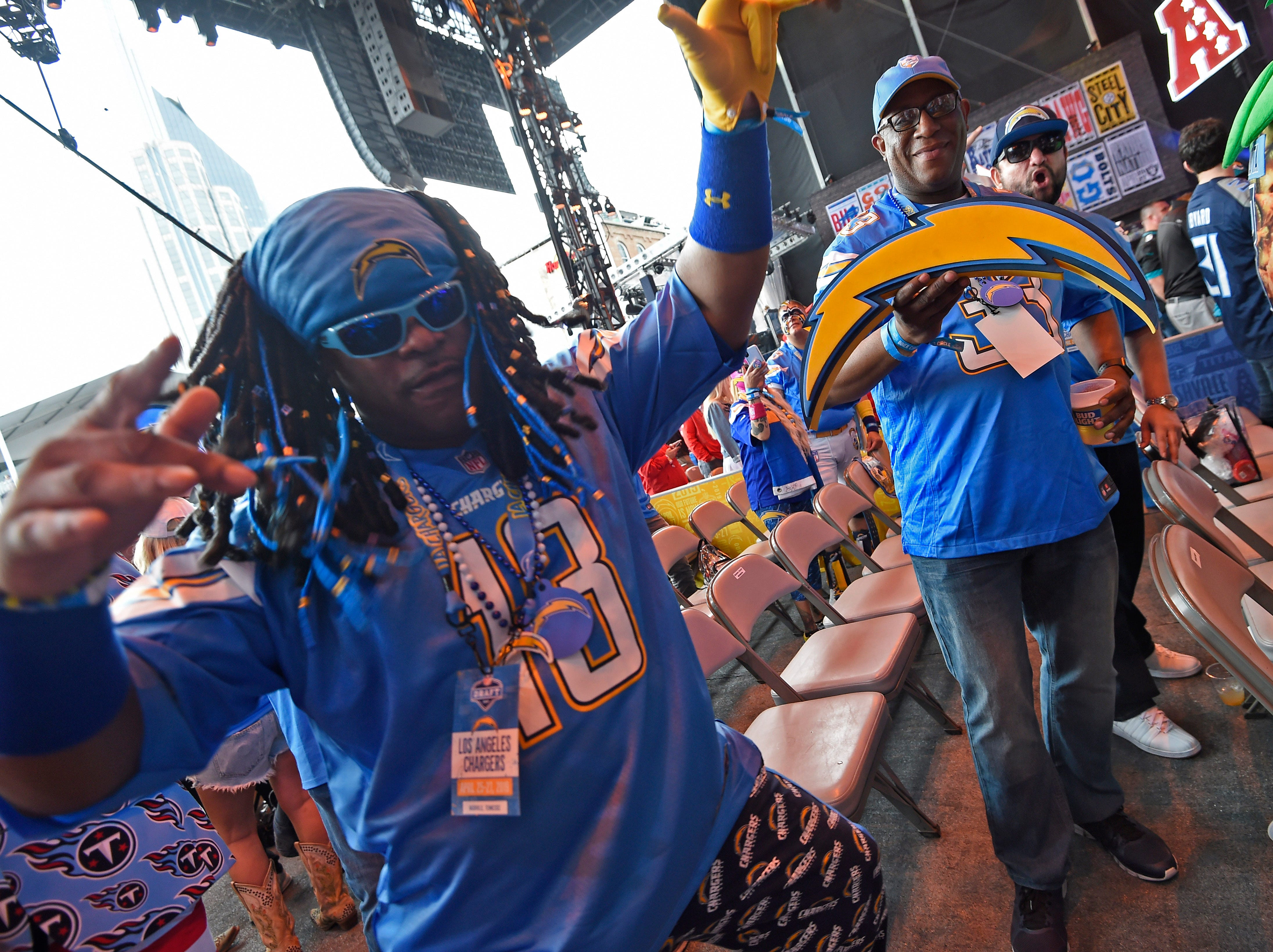 Chargers fans Chester Williams an James Ebo wait for the start of the first round of the NFL Draft Thursday, April 25, 2019, in Nashville, Tenn.