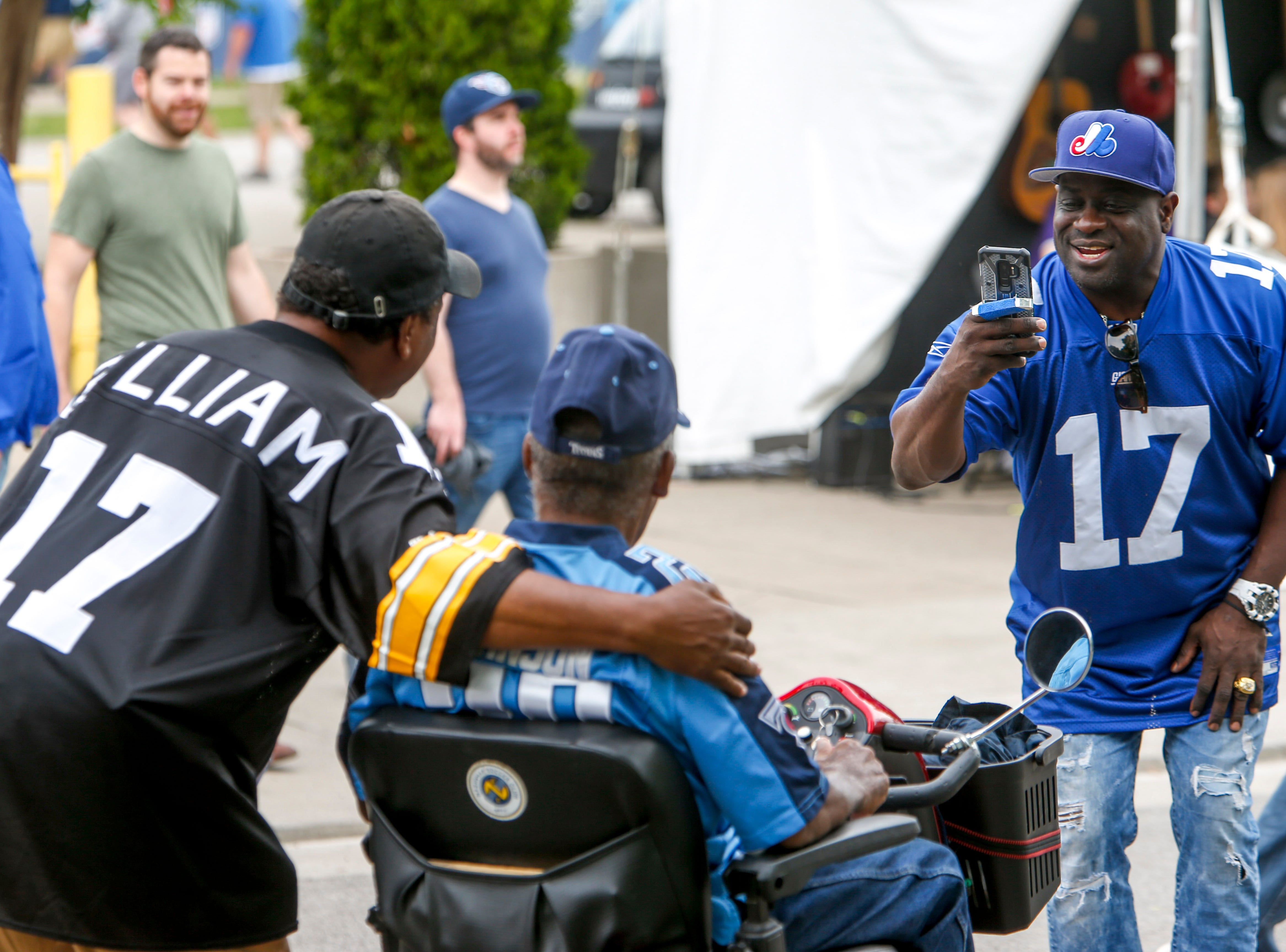 Fans take pictures with friends during the NFL Draft Experience at Nissan Stadium in Nashville, Tenn., on Thursday, April 25, 2019.