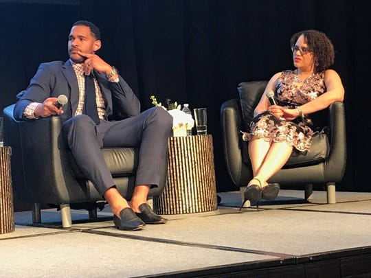 Tennessee Titans linebacker Derrick Morgan and Dina Bennett, curator for the National Museum of African American Music, participate in a panel discussion that explores the intersection of athletics, music and activism.