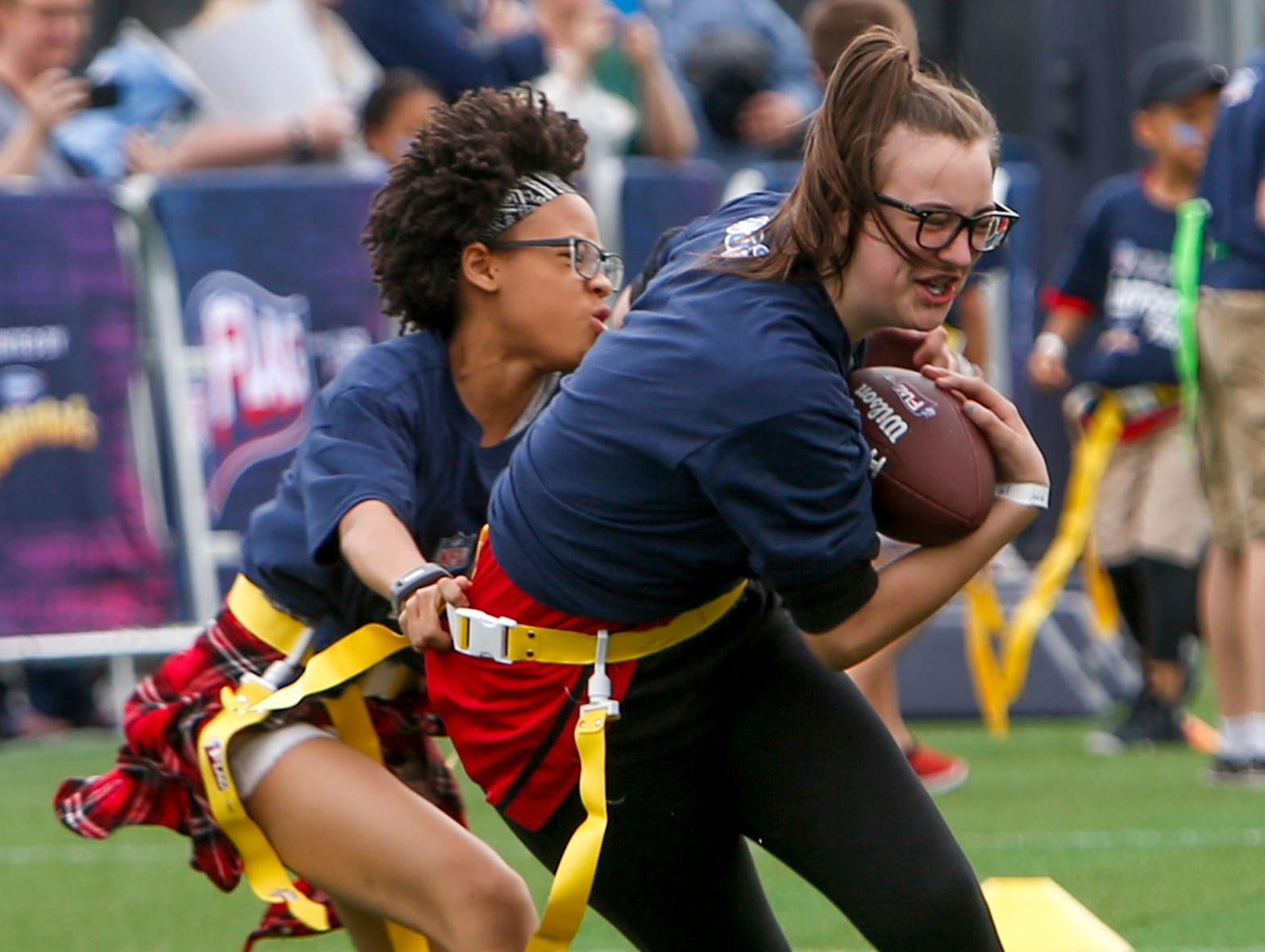 Kids play flag football in a small field during the NFL Draft Experience at Nissan Stadium in Nashville, Tenn., on Thursday, April 25, 2019.