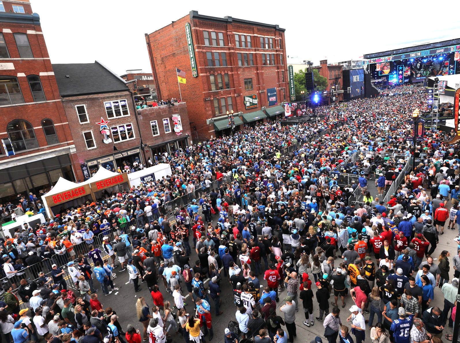 Broadway is filled in this view from the Pinnacle Bank rooftop party on top of Kid Rock's honky tonk before the start of the first round of the NFL Draft Thursday, April 25, 2019, in Nashville, Tenn.