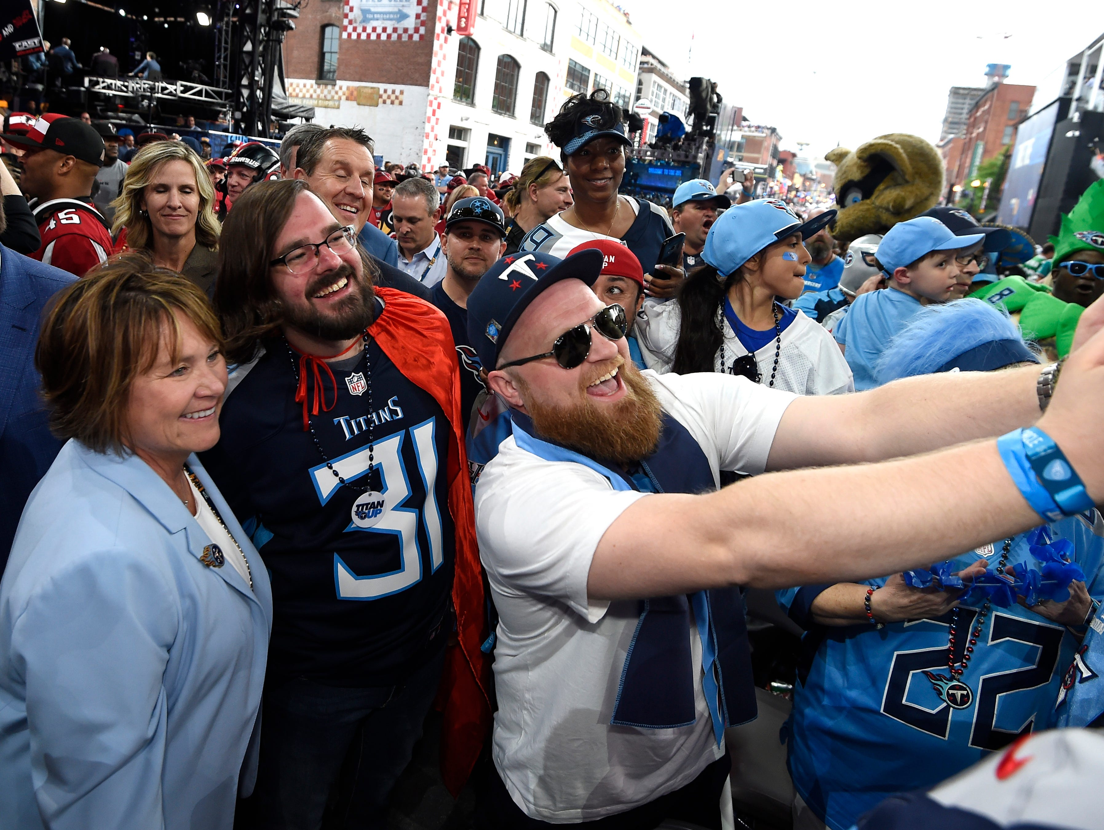 Titans owner Amy Adams Strunk poses for a photo with Titans fans before the first round of the NFL Draft Thursday, April 25, 2019, in Nashville, Tenn.