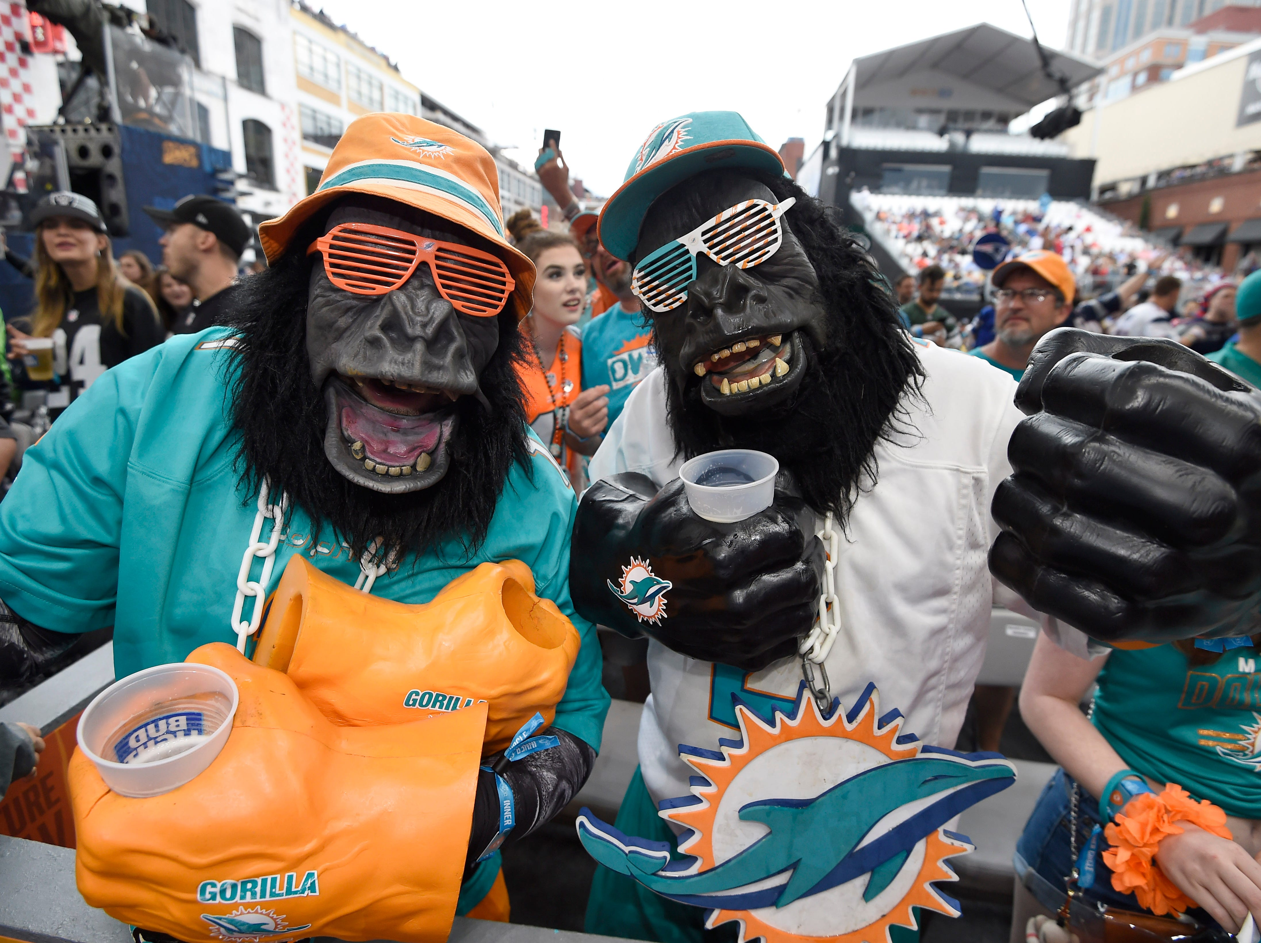Dolphins fans listen to Moon Taxi perform before the first round of the NFL Draft Thursday, April 25, 2019, in Nashville, Tenn.