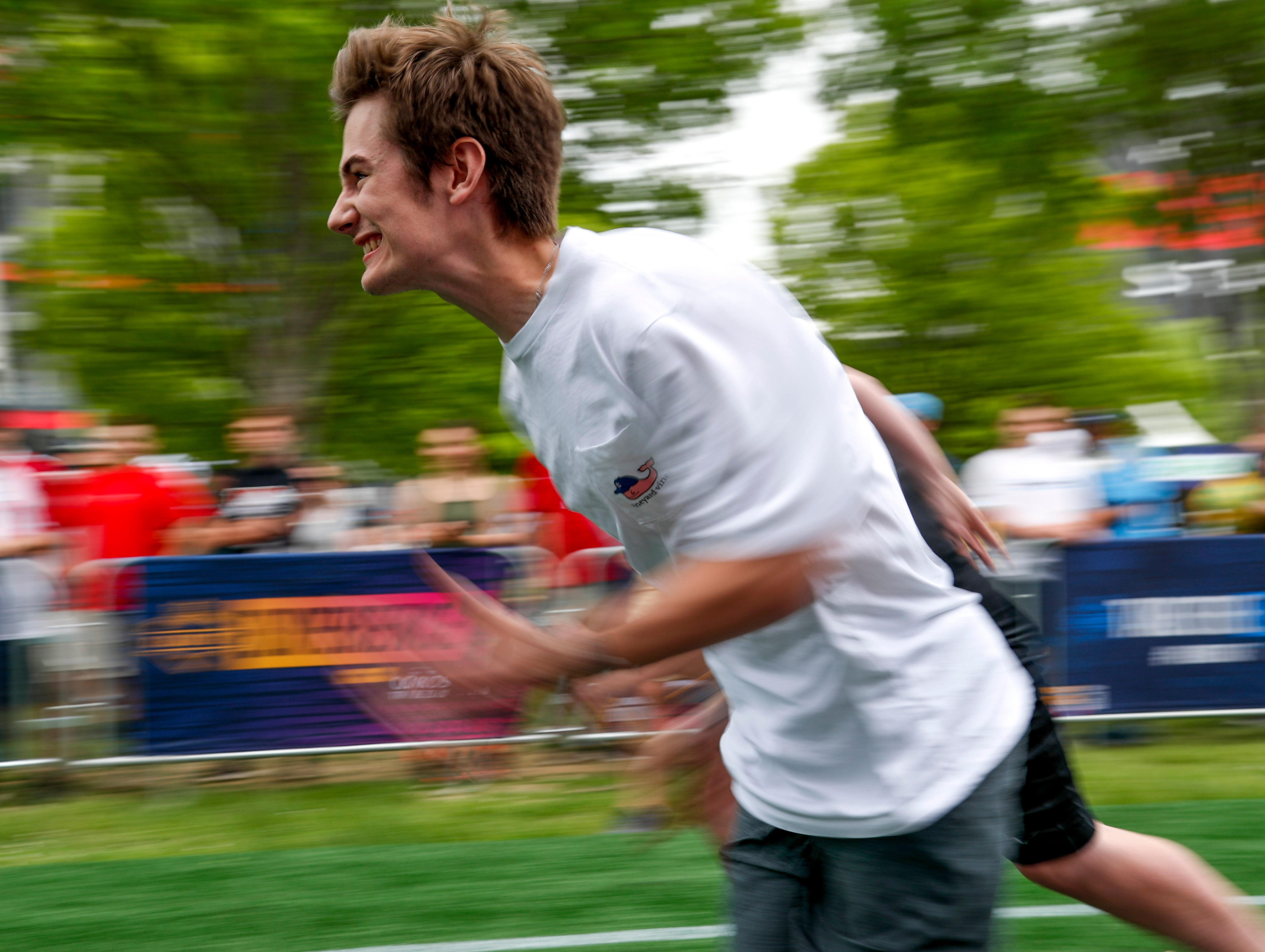Fans sprint down the greenway during the 40 yard dash during the NFL Draft Experience at Nissan Stadium in Nashville, Tenn., on Thursday, April 25, 2019.