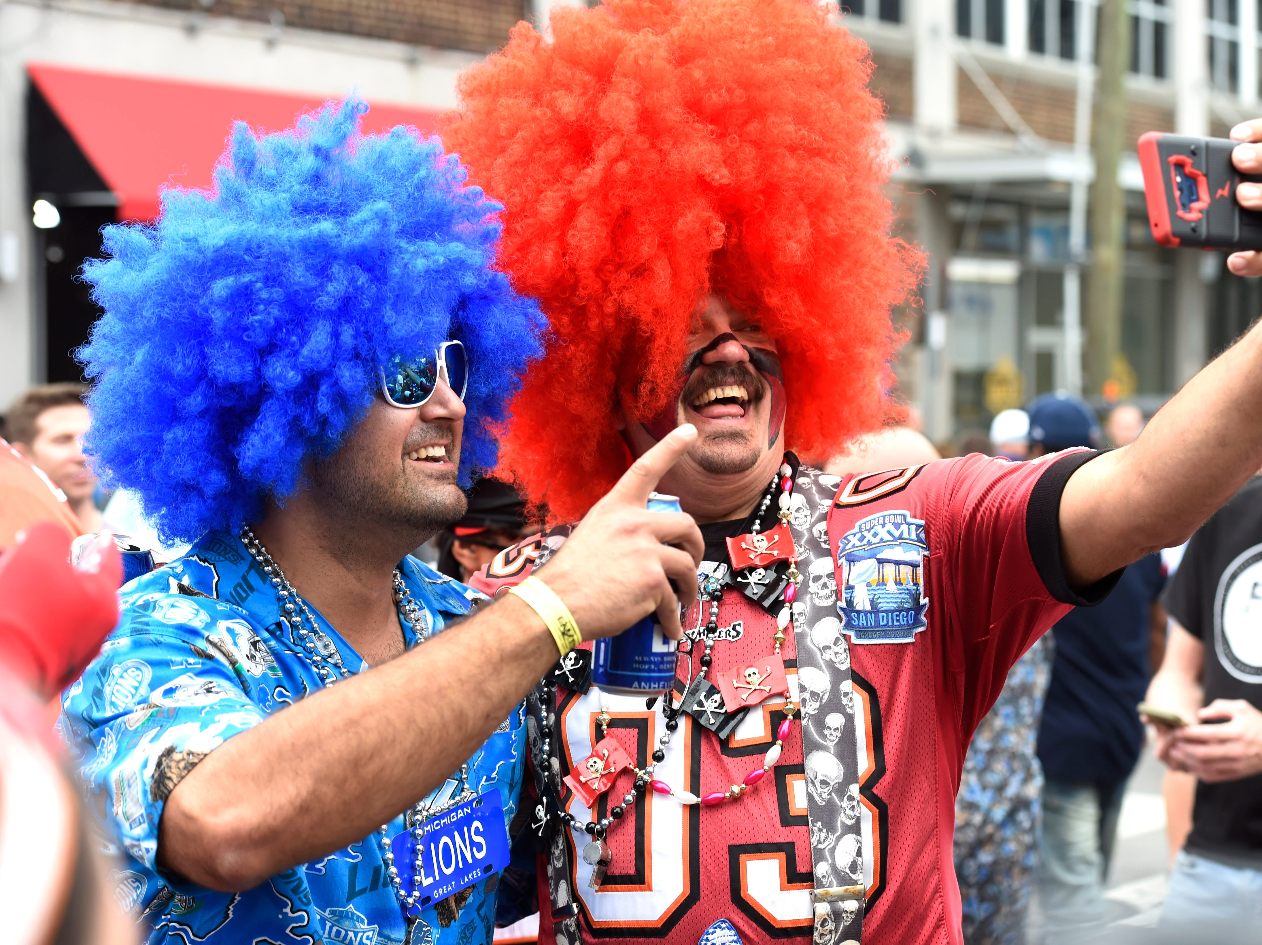 Detroit and Tampa Bay fans take a selfie before the start of first round of the NFL Draft Thursday, April 25, 2019 in Nashville, Tenn.