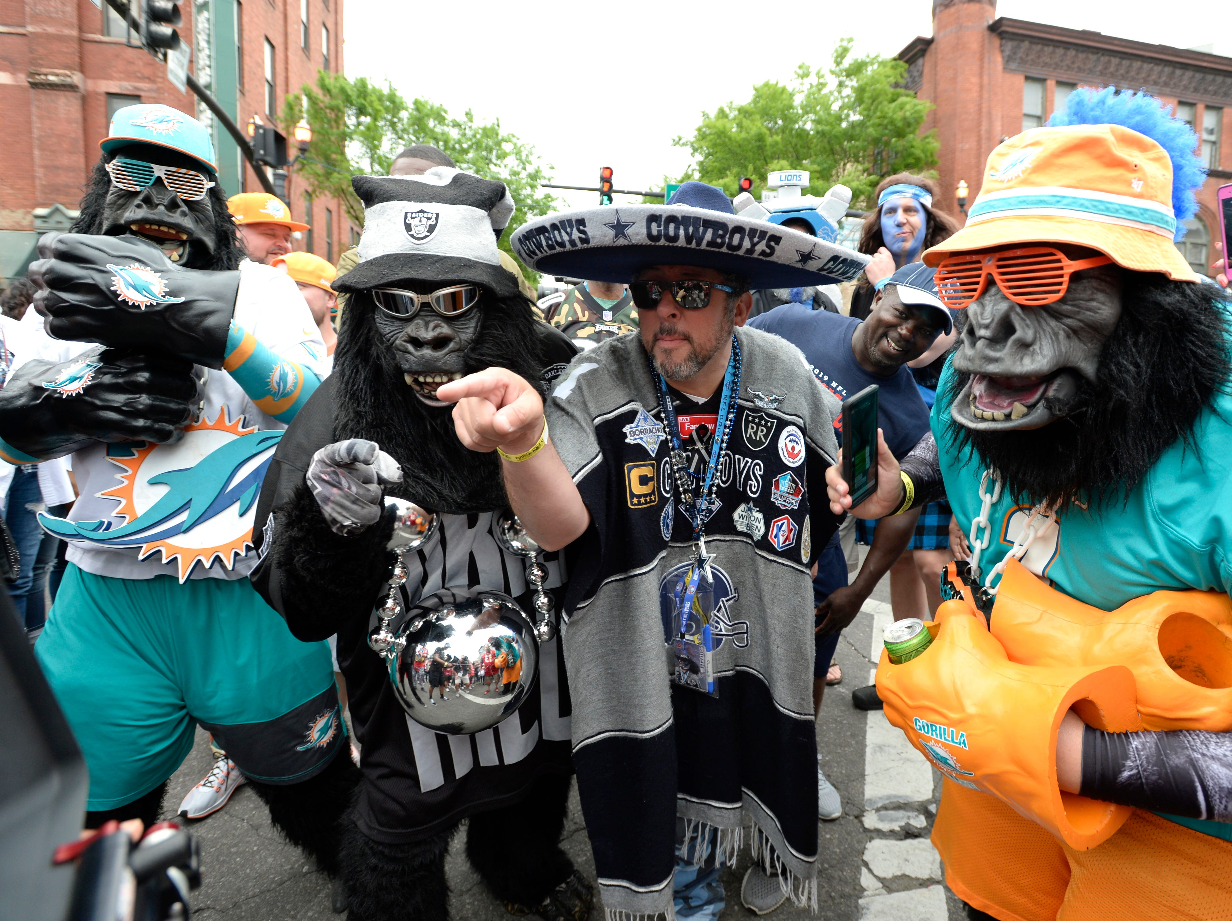 Miami, Oakland and Dallas fans celebrate before the start of the first round of the NFL Draft Thursday, April 25, 2019 in Nashville, Tenn.