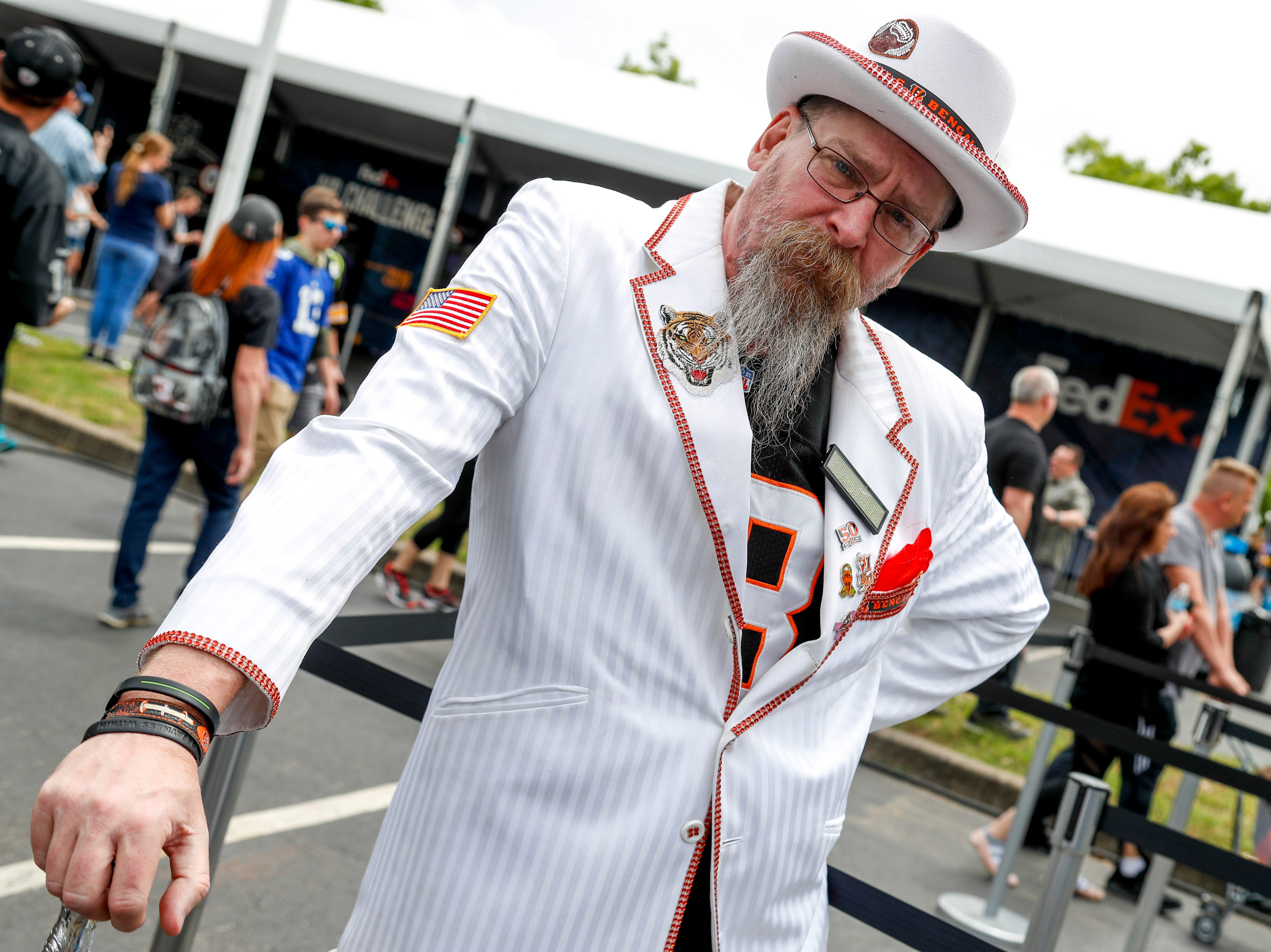 Dave Tash holds his Bengals themed cane with eloquence while waiting in line for autographs during the NFL Draft Experience at Nissan Stadium in Nashville, Tenn., on Thursday, April 25, 2019.