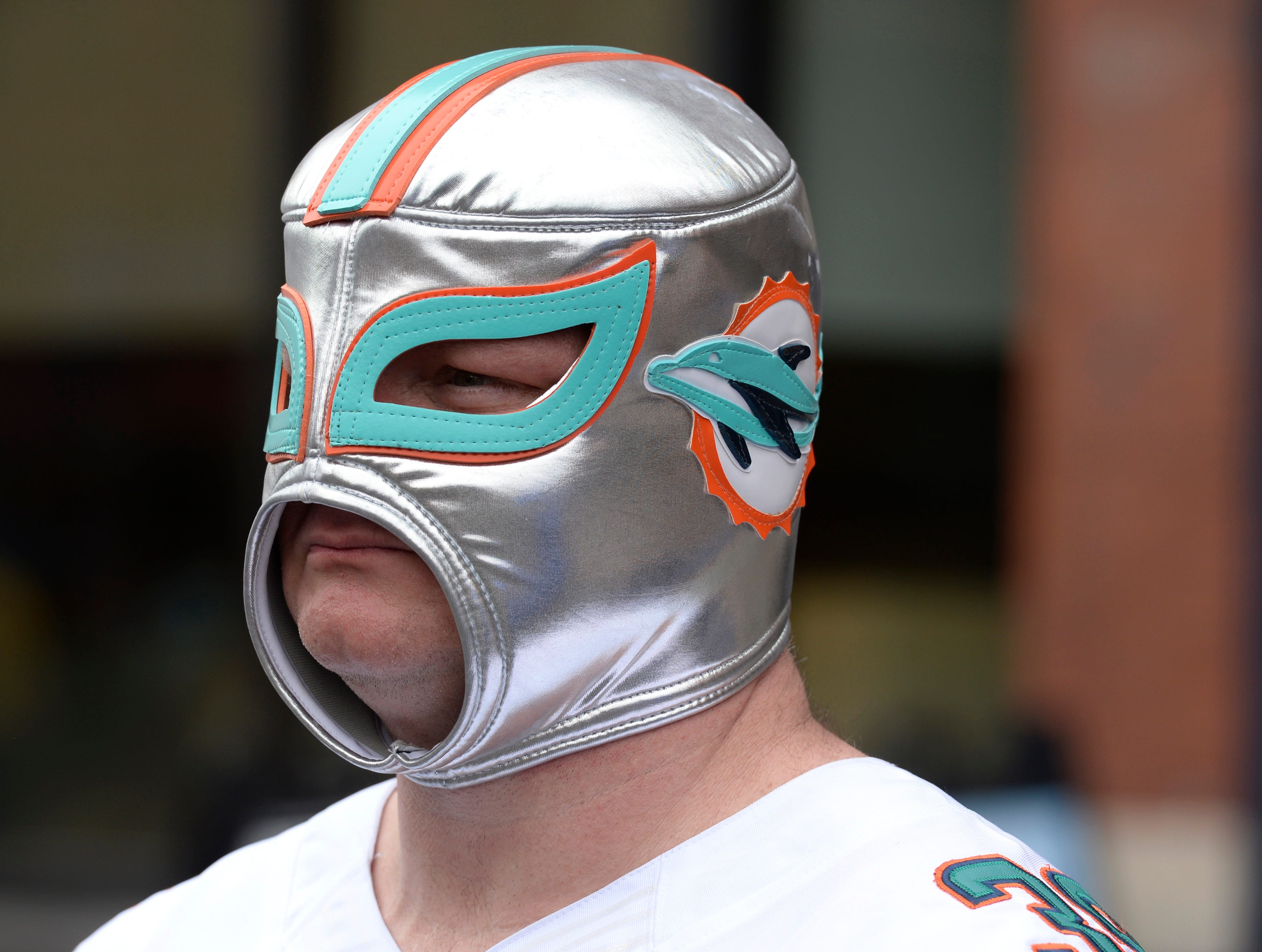 Dolphins fan Curtis McCurry walks along the Lower Broadway before the start of the 2019 NFL Draft in Nashville, Tenn., Thursday, April 25, 2019.