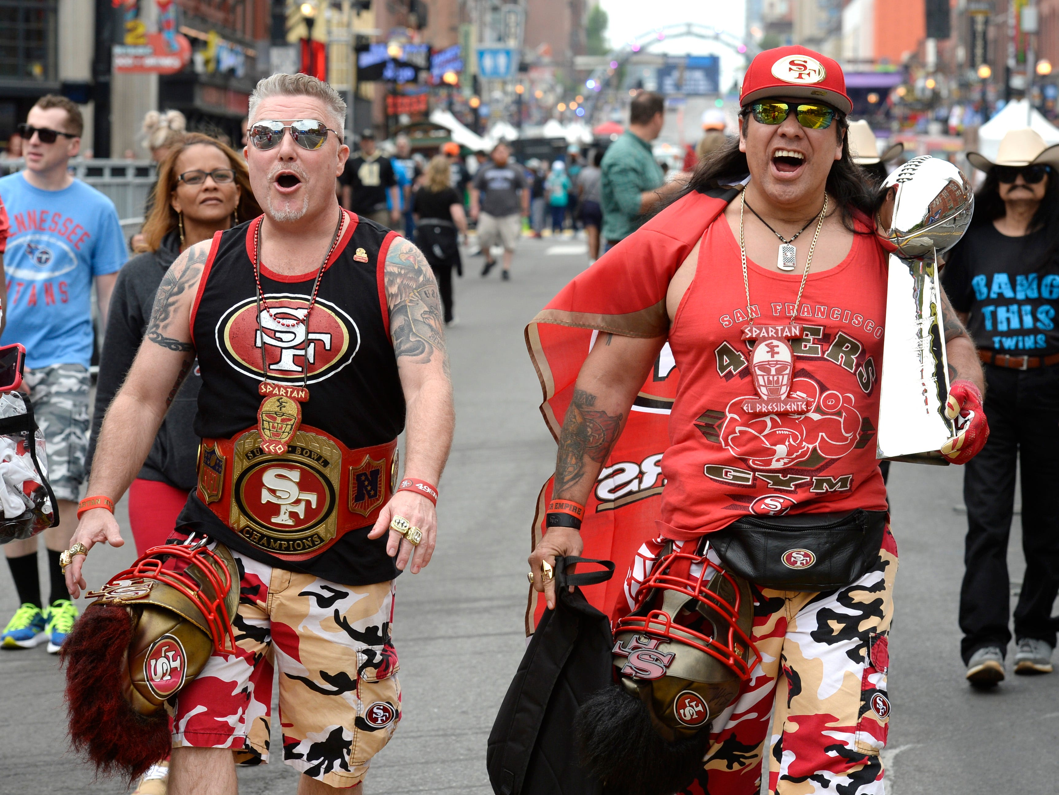 Niners fans Dave Kahn and Pedro Torales show their allegiance before the start of the 2019 NFL Draft on Lower Broadway in Nashville, Tenn., Thursday, April 25, 2019.