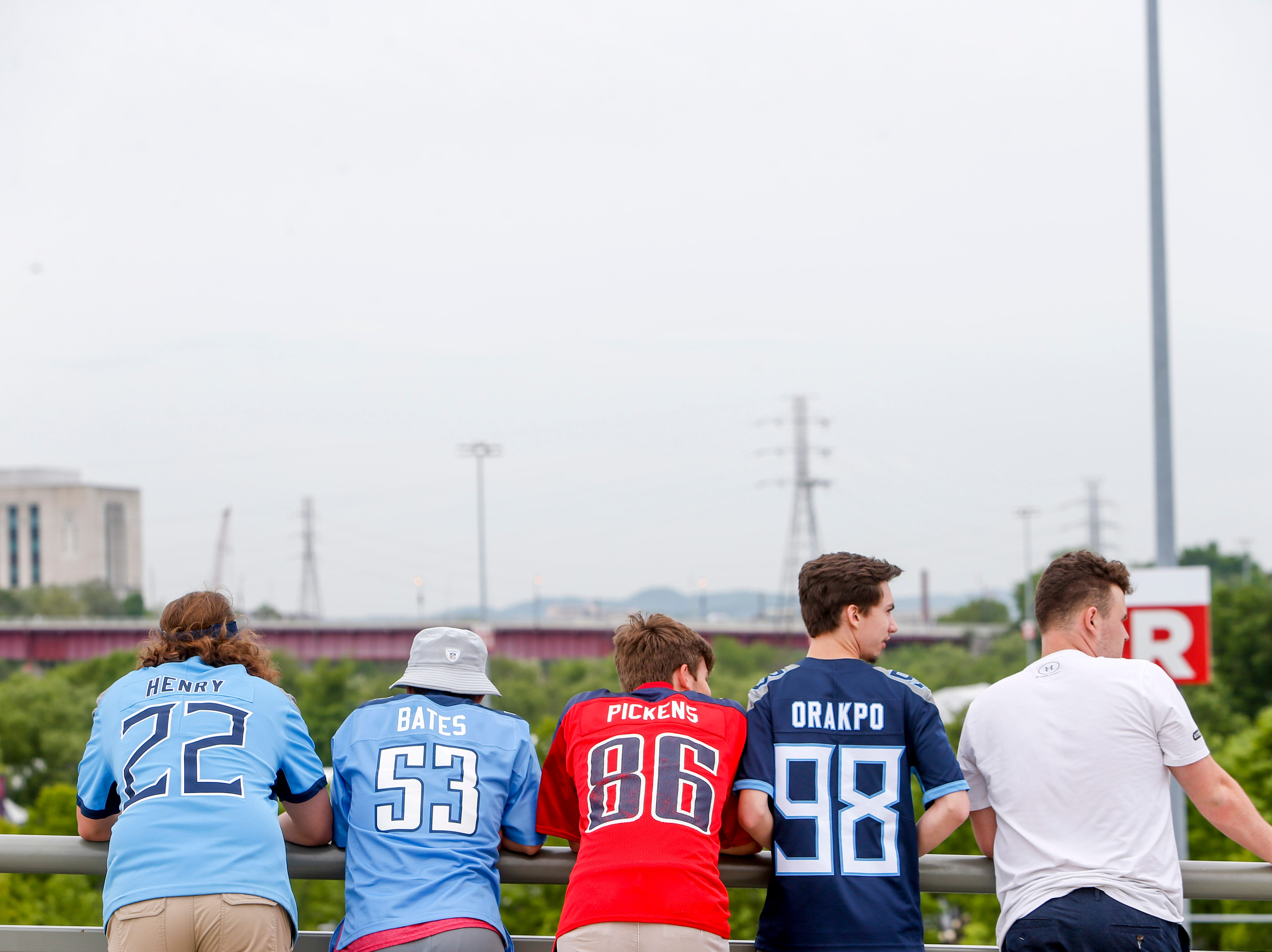Fans line up at the railing of the bridge during the NFL Draft Experience at Nissan Stadium in Nashville, Tenn., on Thursday, April 25, 2019.