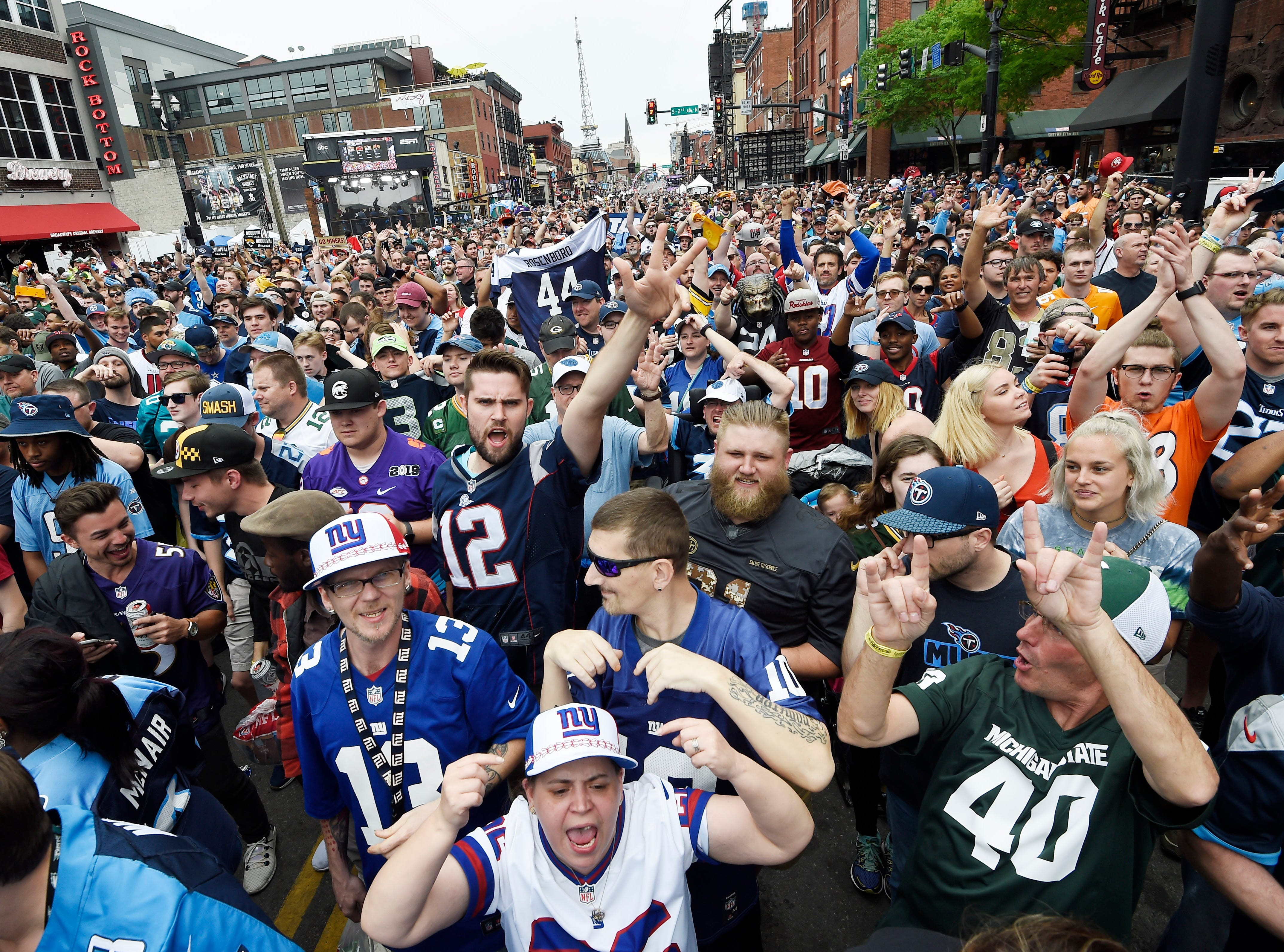 Football fans fill Lower Broadway before the start of the first round of the NFL Draft Thursday, April 25, 2019 in Nashville, Tenn.