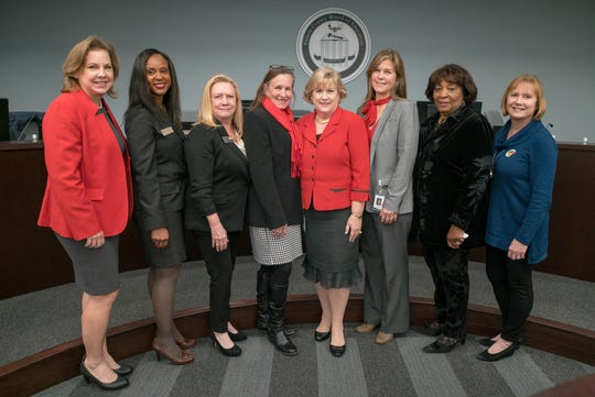 Julia Bernath, far right, with Fulton County Schools board members and the district's interim Superintendent Cindy Loe.