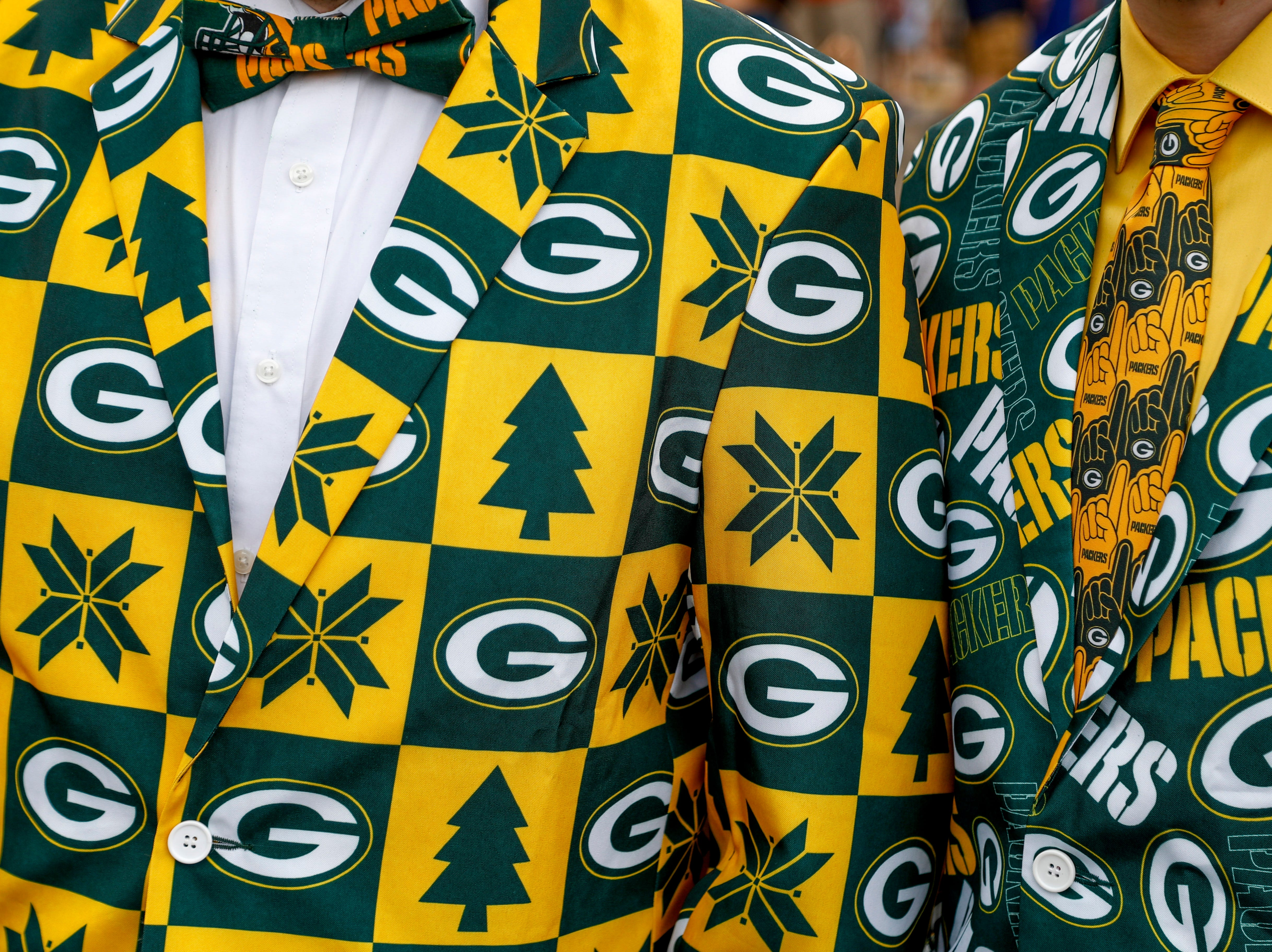 Packers fans strut bowties and jackets to compliment their team outfits during the NFL Draft Experience at Nissan Stadium in Nashville, Tenn., on Thursday, April 25, 2019.