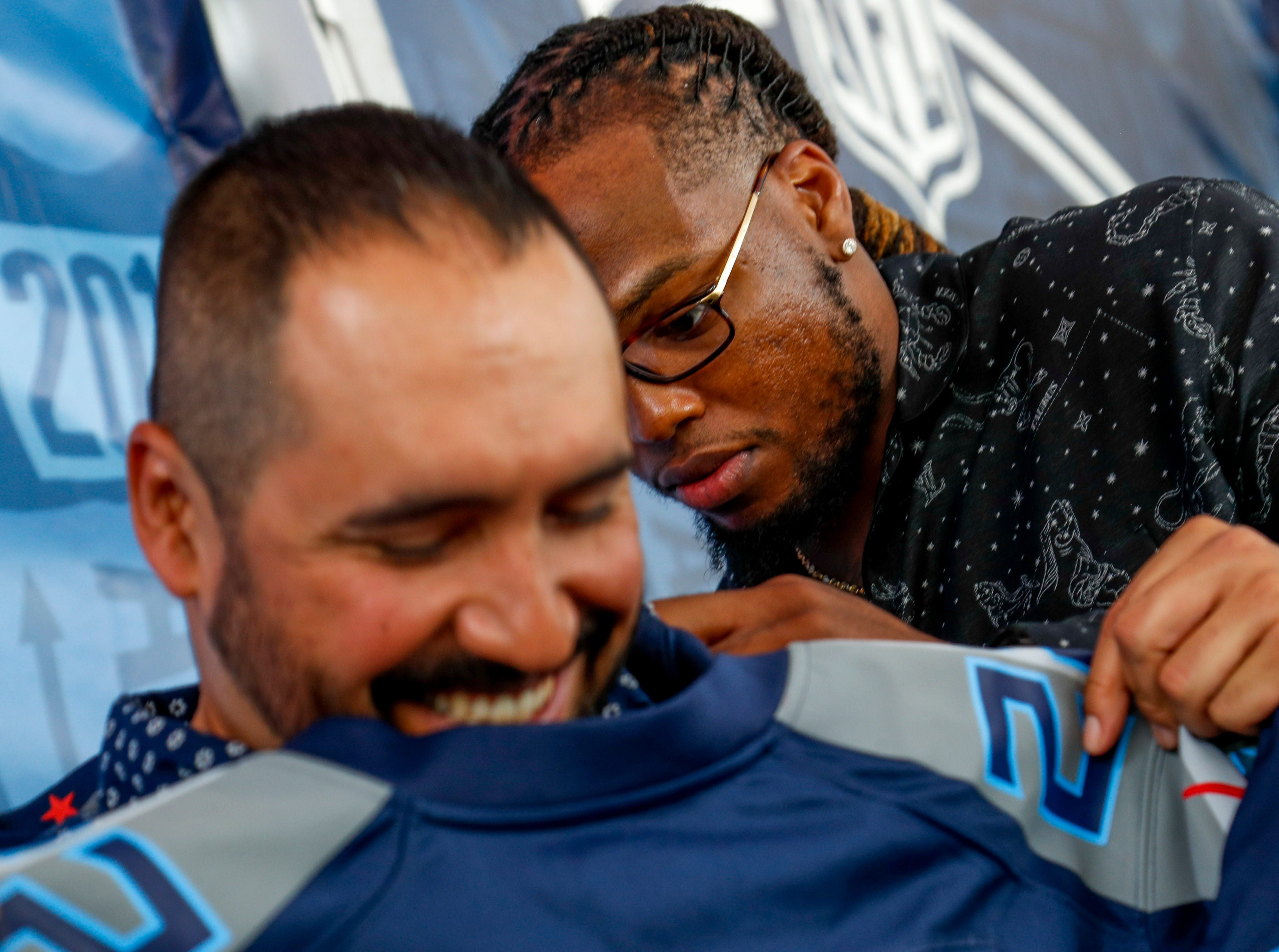 Titans running back Derrick Henry signs a jersey on the back of retired SFC Ralph Rodriguez during the NFL Draft Experience at Nissan Stadium in Nashville, Tenn., on Thursday, April 25, 2019.