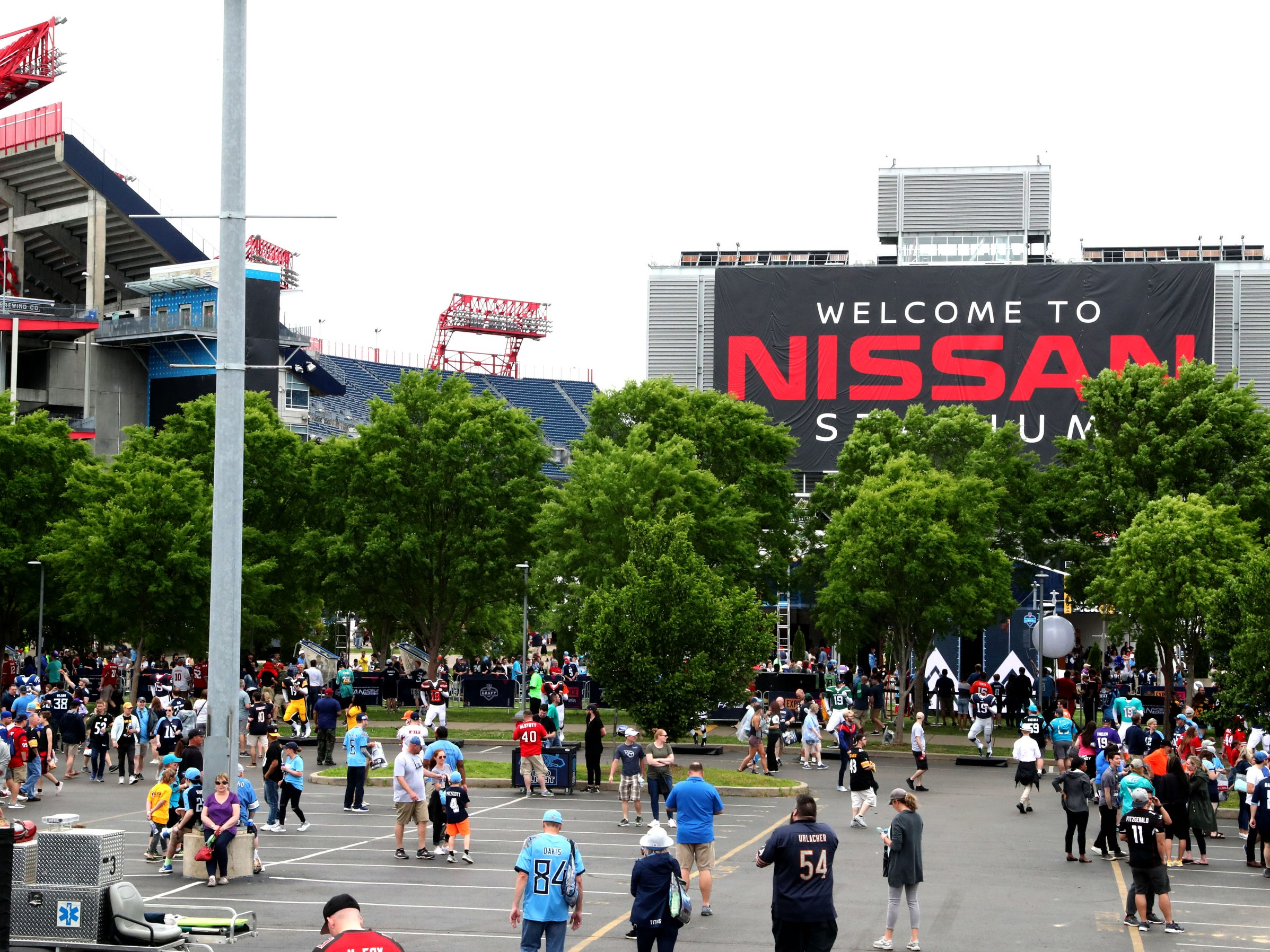 People wander around in the NFL Draft Experience, at Nissan Stadium on Thursday, April 25, 2019, in Nashville, Tennessee.