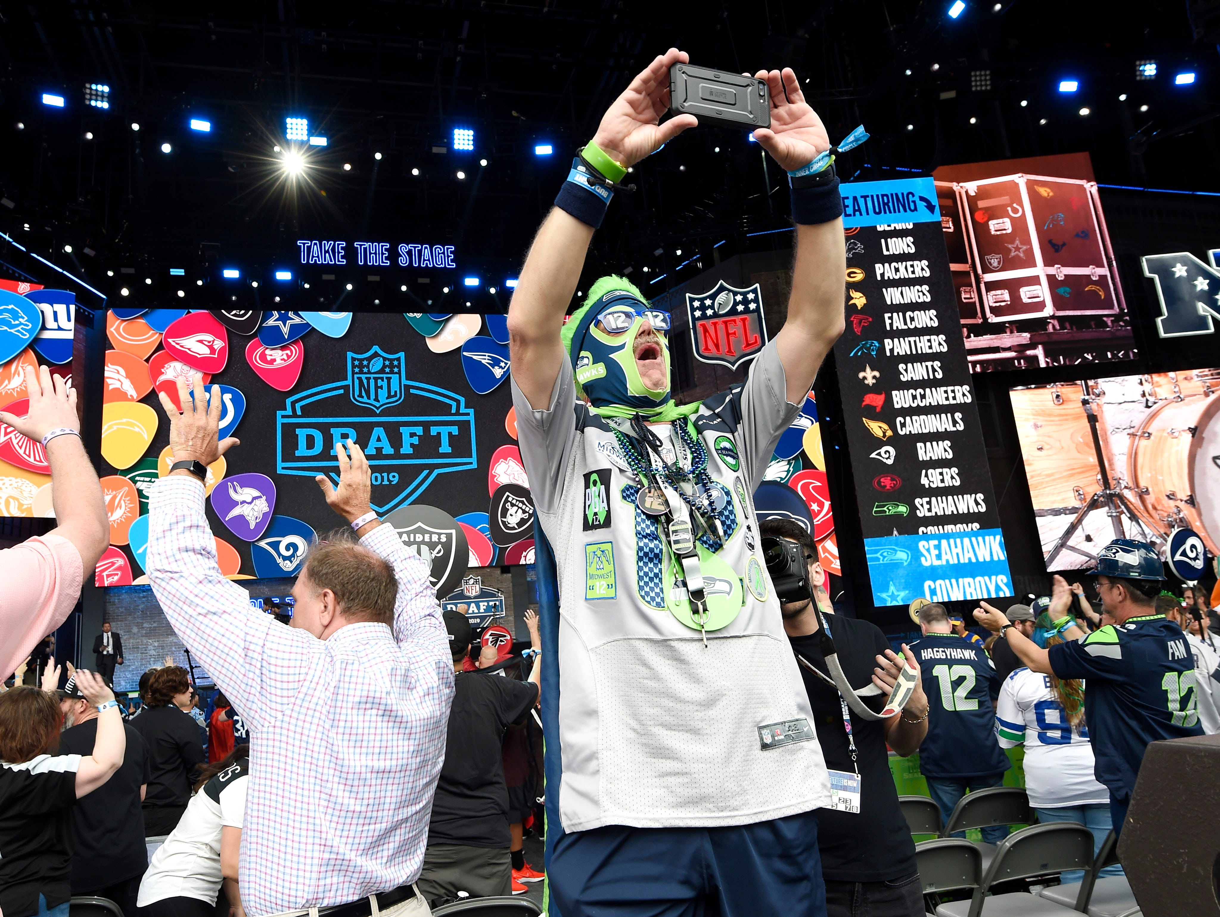 Seahawks fan Harold Cunningham of Springfield, Mo., takes a selfie before the start of the first round of the NFL Draft  Thursday, April 25, 2019 in Nashville, Tenn.