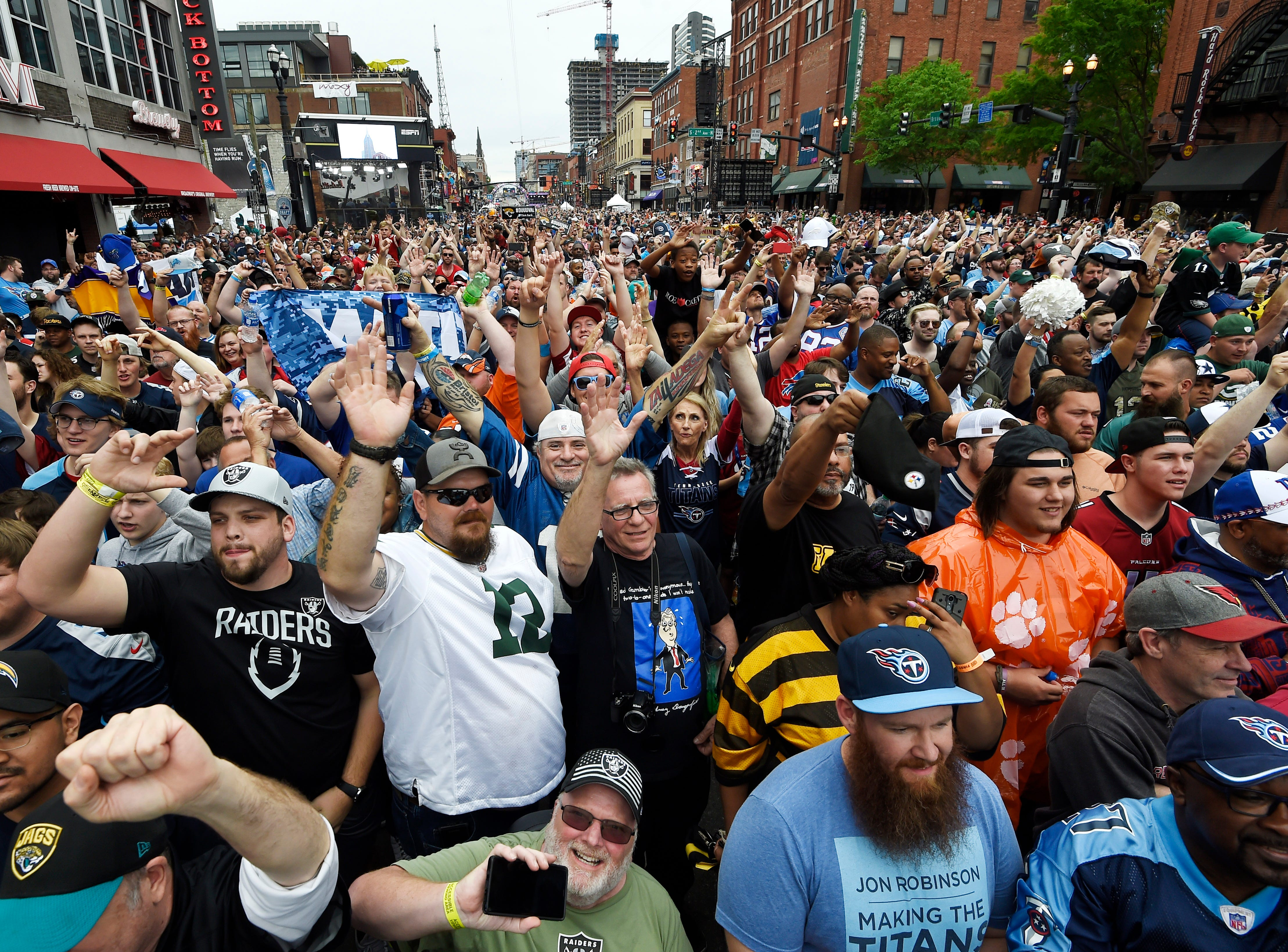 Fans fill Lower Broadway before the first round of the NFL Draft Thursday, April 25, 2019 in Nashville, Tenn.