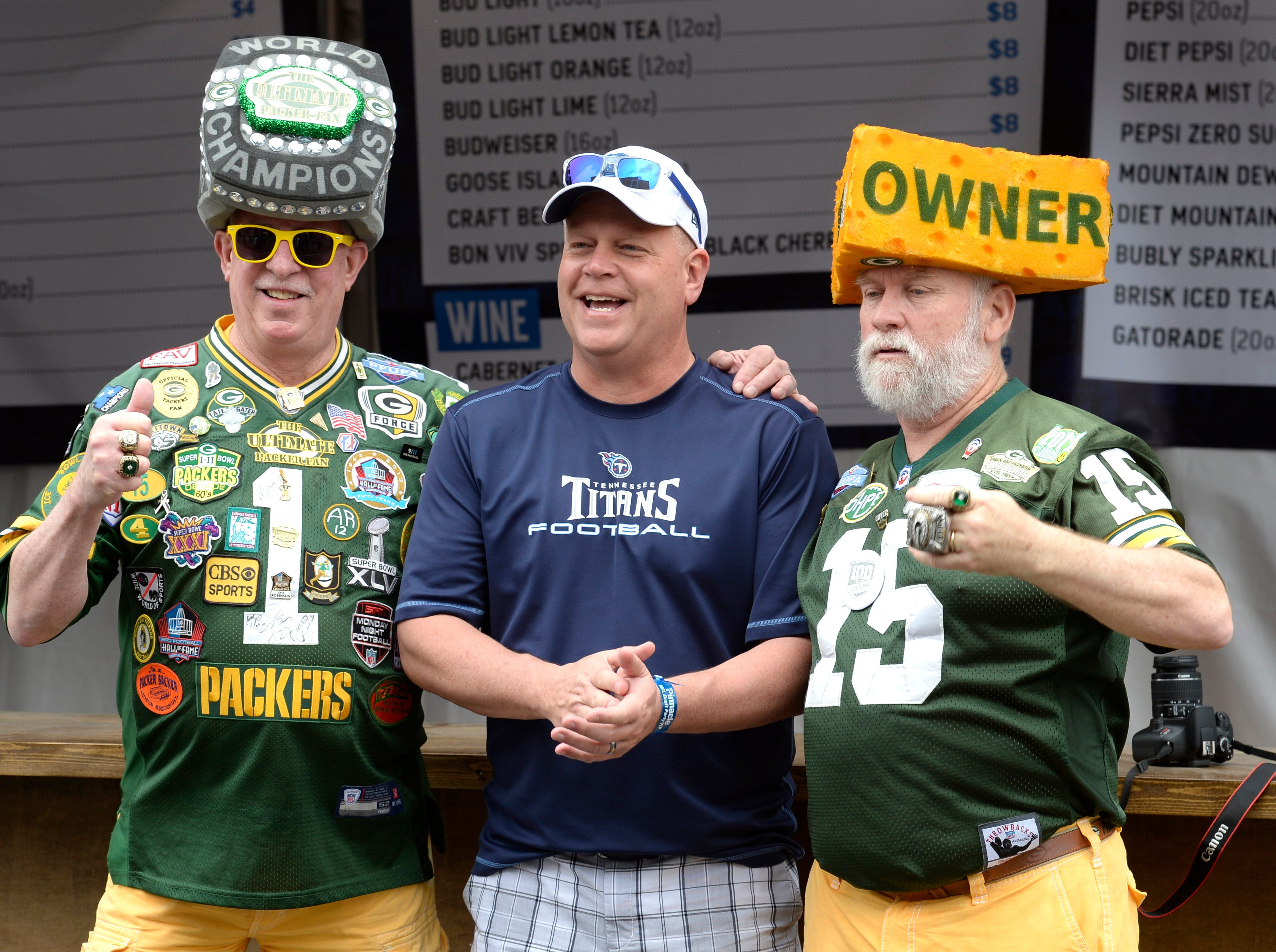 Steve Tate, David Dolleris and Wayne Sargent show off their favorite teams before the start of the 2019 NFL Draft on Lower Broadway  in Nashville, Tenn., Thursday, April 25, 2019.