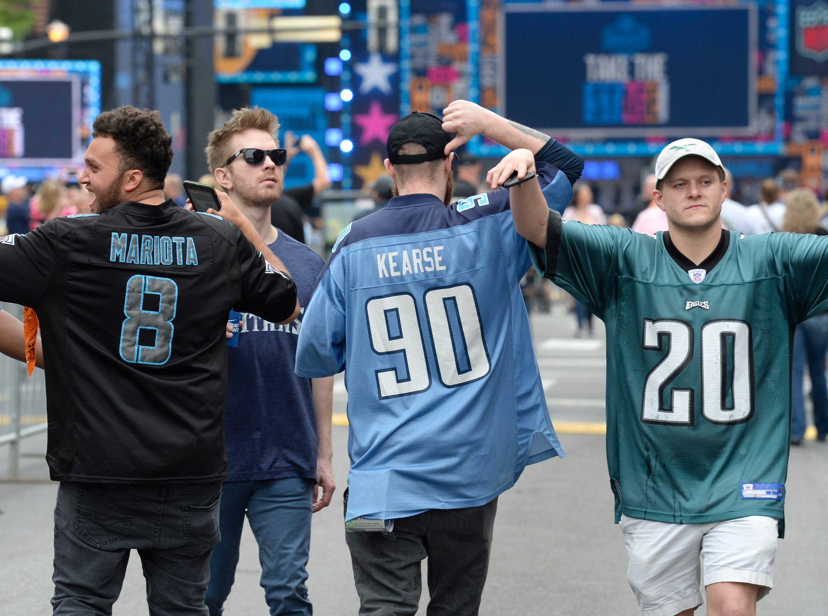 A group of fans show their allegiance before the start of the 2019 NFL Draft on Lower Broadway in Nashville, Tenn., Thursday, April 25, 2019.