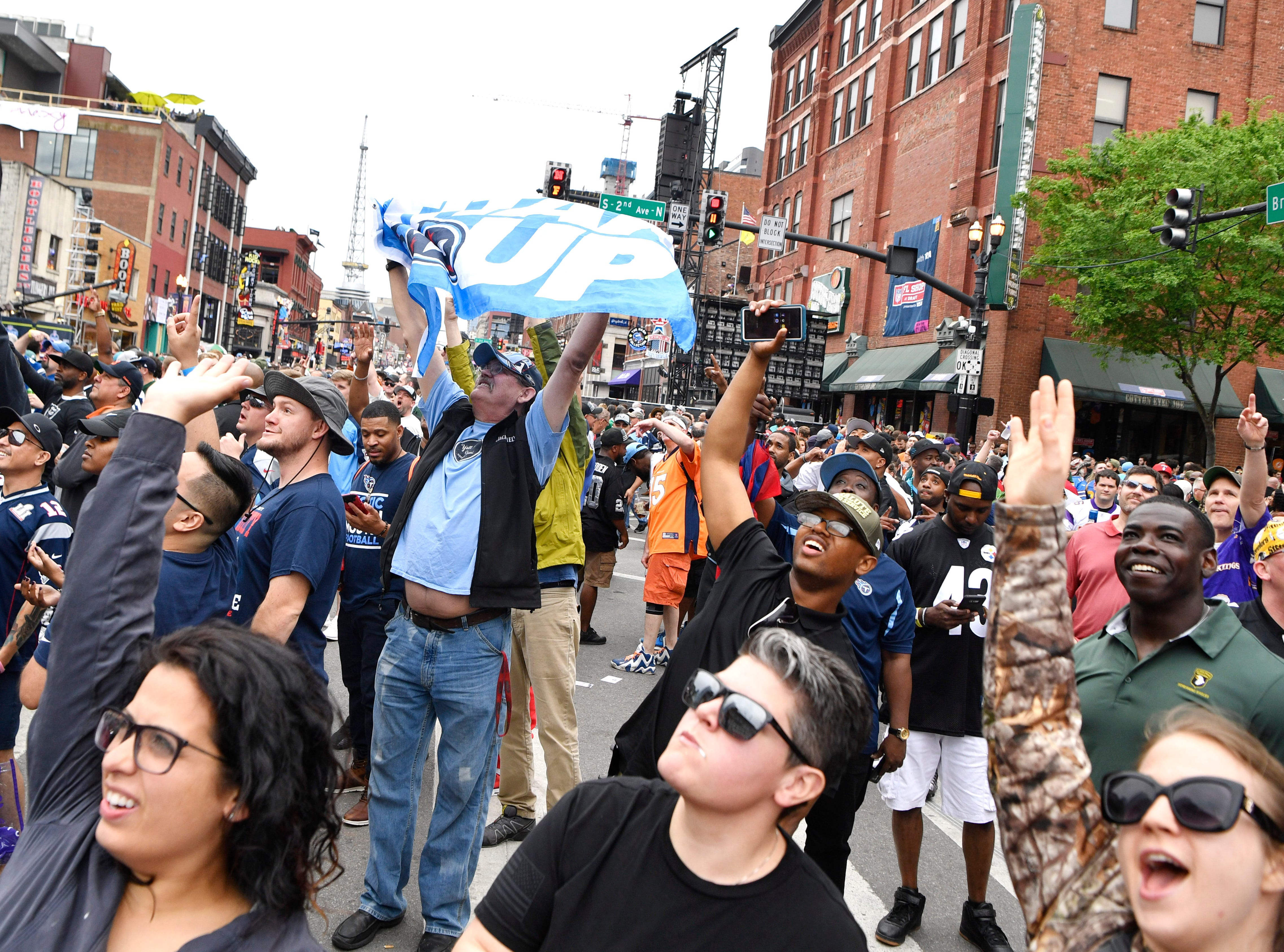 Fans cheer before the start of the first round of the NFL Draft Thursday, April 25, 2019 in Nashville, Tenn.