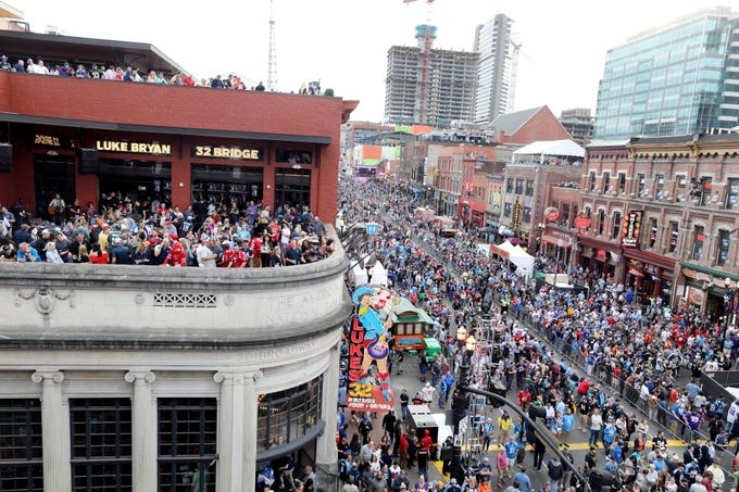The view from the rooftop Pinnacle Bank party atop Kid Rock's honky tonk looking down Broadway before the first round of the NFL Draft Thursday, April 25, 2019, in Nashville, Tenn.
