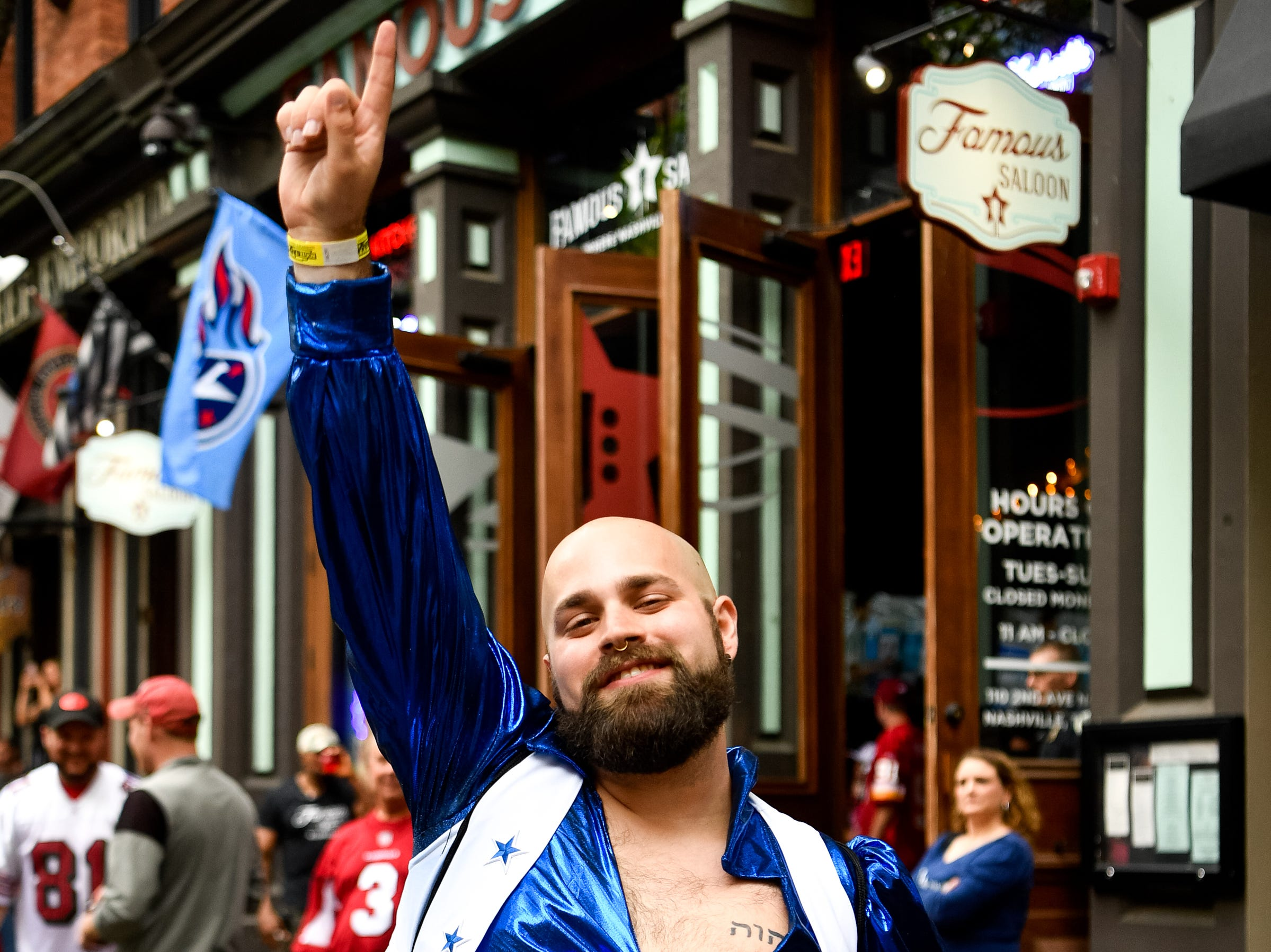 Josh Darretta poses for a photo in the only costume left to purchase, just off Lower Broadway during the NFL Draft Thursday, April 25, 2019, in Nashville, Tenn.