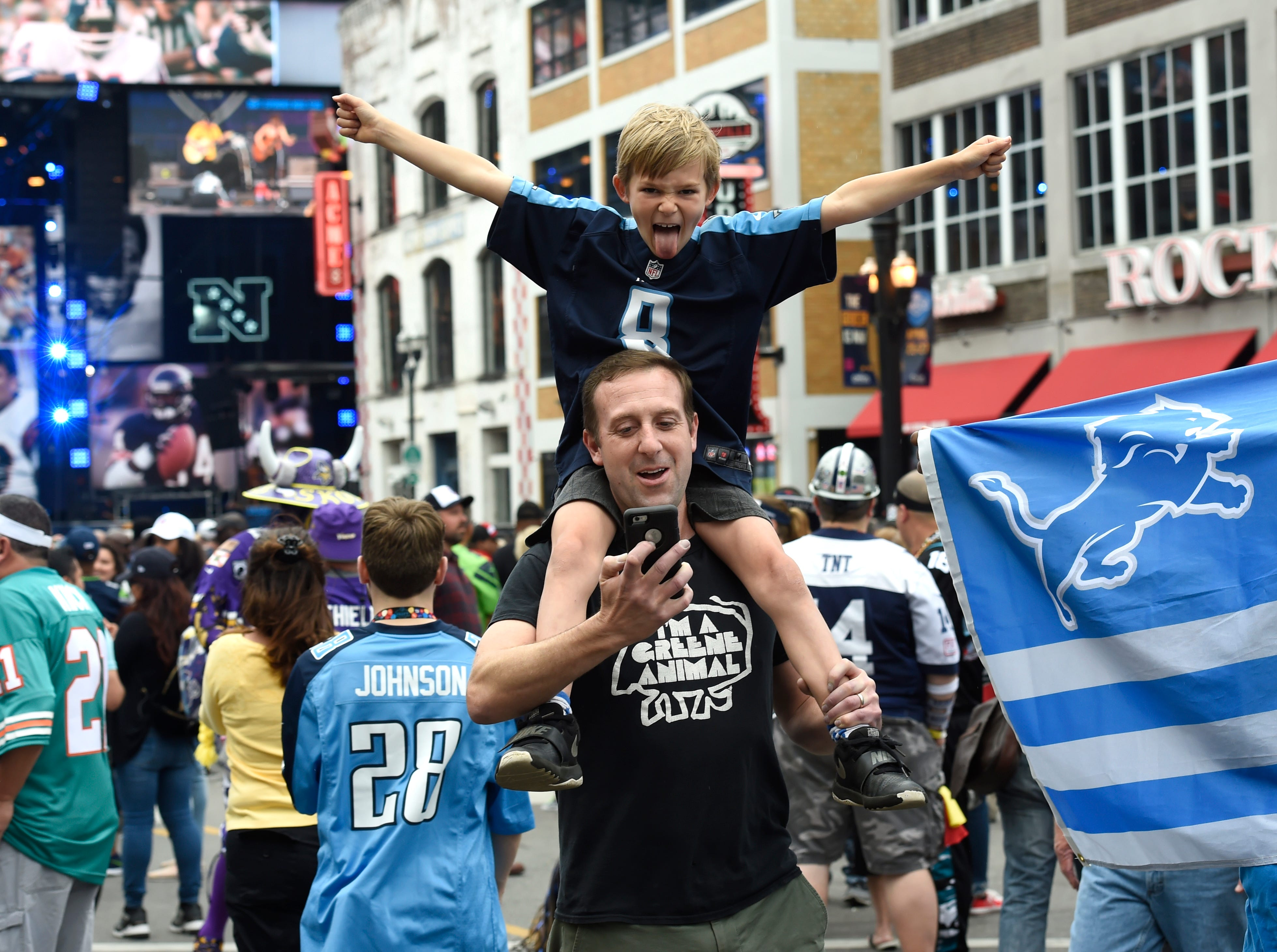 James Greene and his son, Jordan, enjoy Lower Broadway before the start of the first round of the NFL Draft Thursday, April 25, 2019 in Nashville, Tenn.