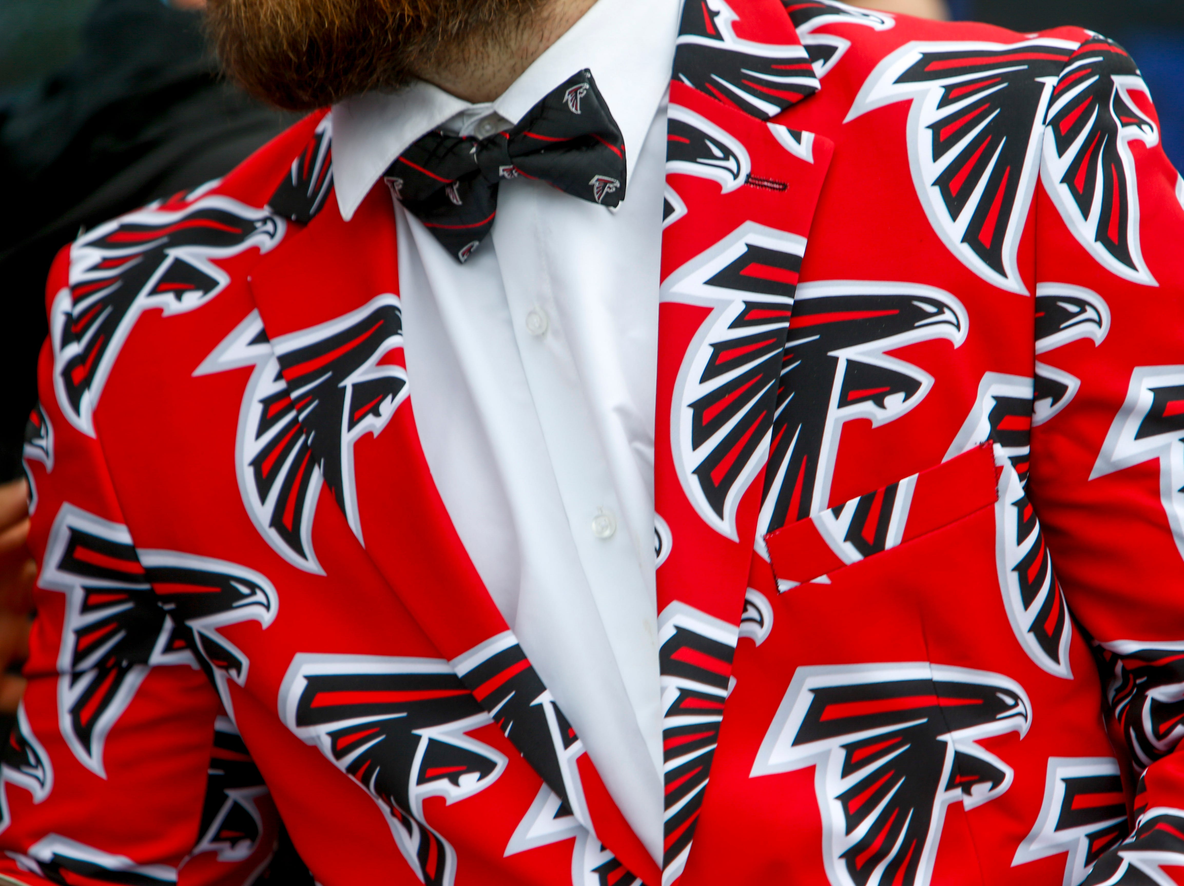 A fan struts up to meet Marcus Mariota with full Falcons flare during the NFL Draft Experience at Nissan Stadium in Nashville, Tenn., on Thursday, April 25, 2019.