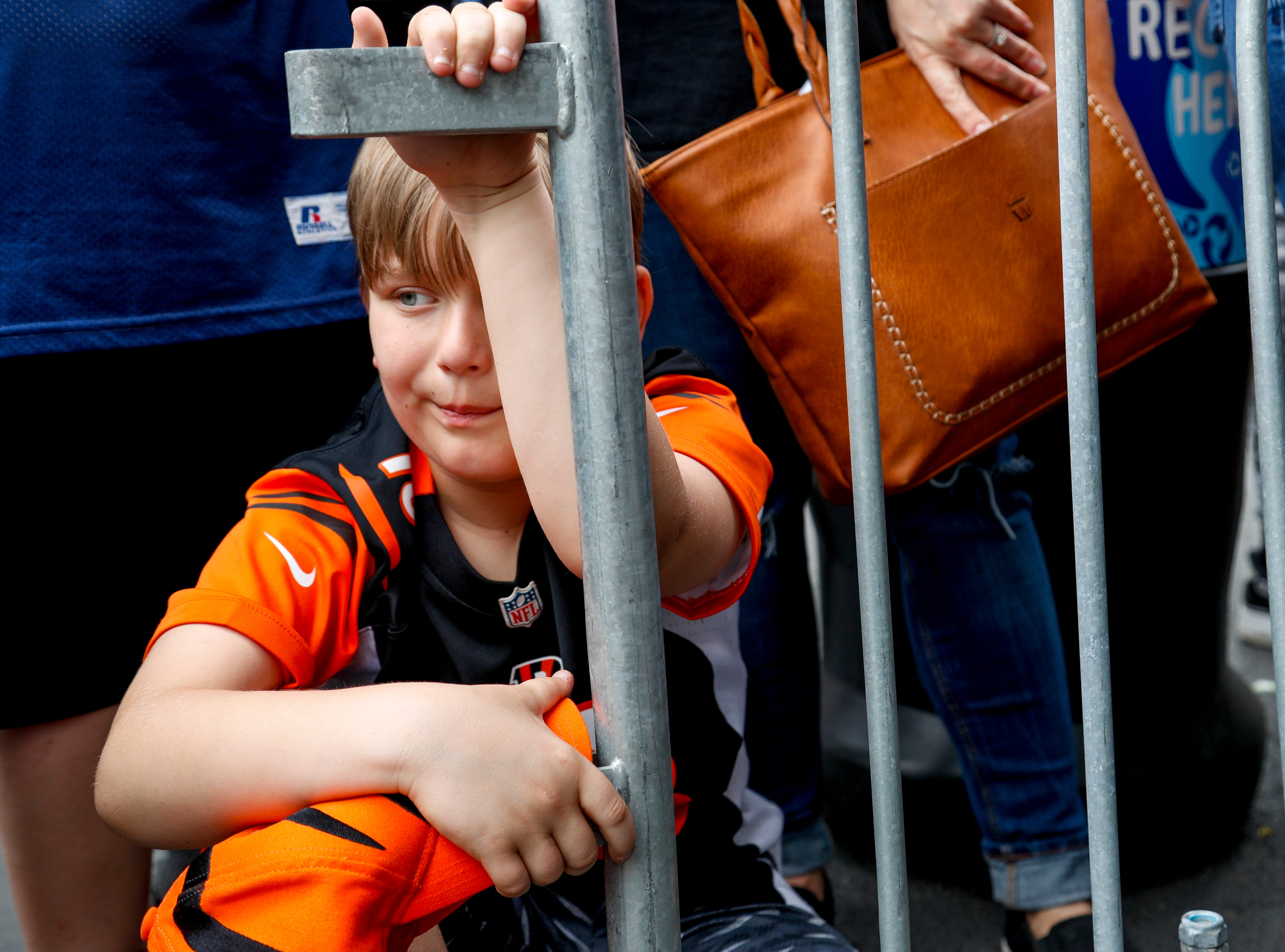 Dawson Early, 10, kneels down while waiting patiently for Derrick Henry to appear during the NFL Draft Experience at Nissan Stadium in Nashville, Tenn., on Thursday, April 25, 2019.