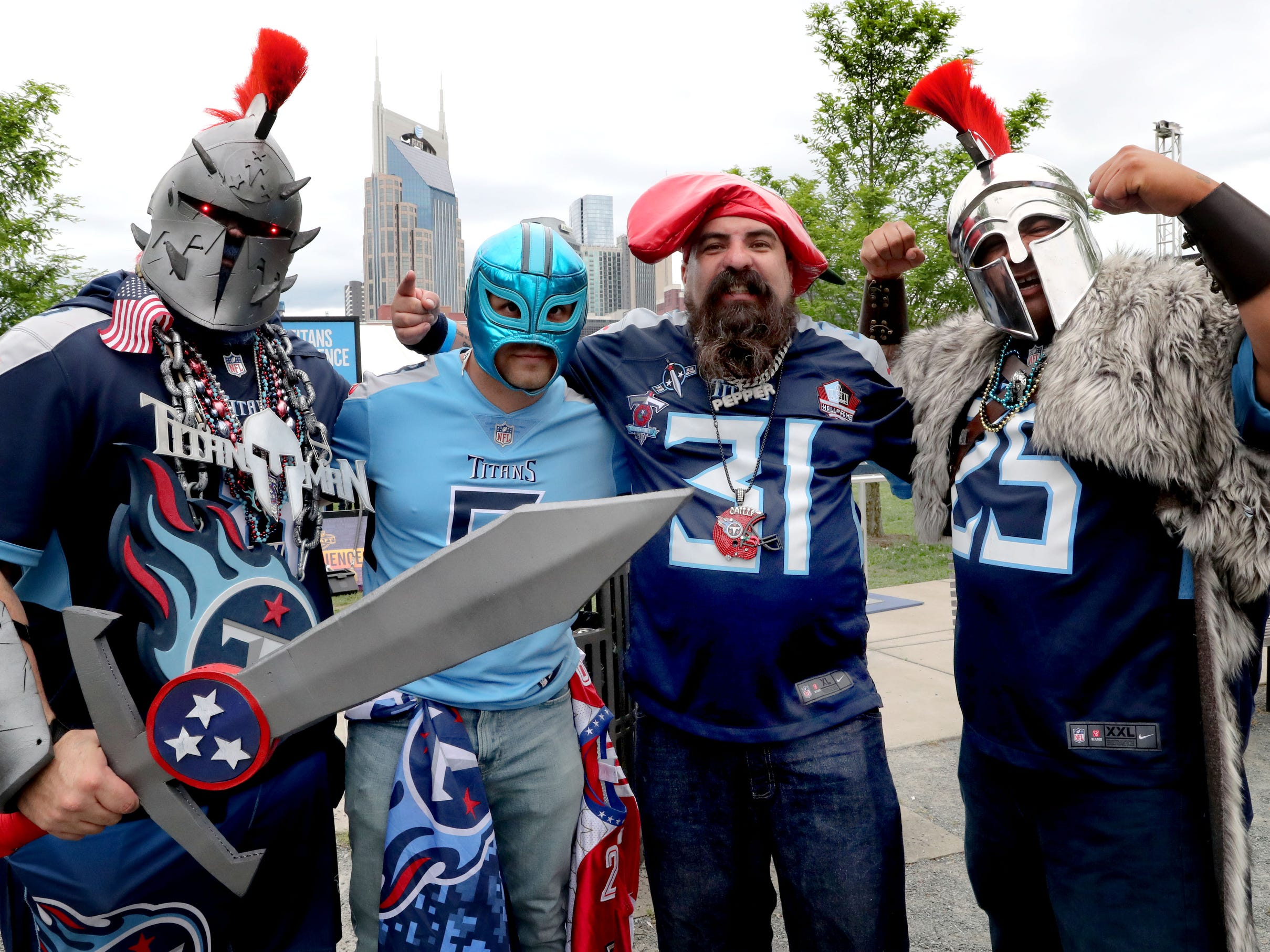 (L toR) Adam McMillan, as Titan Man, Nestor Patino, as Titan Misterio, Fernando Espejo as Chilly Pepper, and Onne Villarreal as Mr. A'oo strike a pose next to the Nashville Skyline, at the NFL Draft Experience, at Nissan Stadium on Thursday, April 25, 2019, in Nashville, Tennessee.