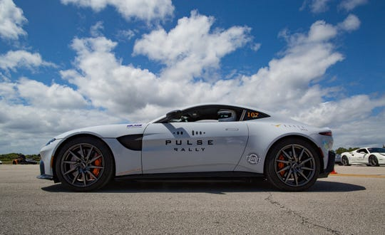 Charles Turner prepares to push his Aston Martin Vantage to its limit on a 2.3-mile stretch of the former space shuttle landing strip at the Kennedy Space Center in March 2019. He is originally from Hershey, Pennsylvania, and now a resident of Naples. He participated in the rally with his son Jonathan.
