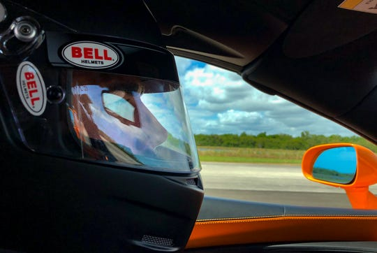 Jonathan Turner turns his firm gaze on the road as his McLaren 570S reaches beyond 200 mph on a 2.3-mile stretch of the former space shuttle landing strip at Kennedy Space Center during Pulse Rally in March 2019. Turner is a financial adviser who lives a part of the year in Naples and attended the rally with his father, Charles.
