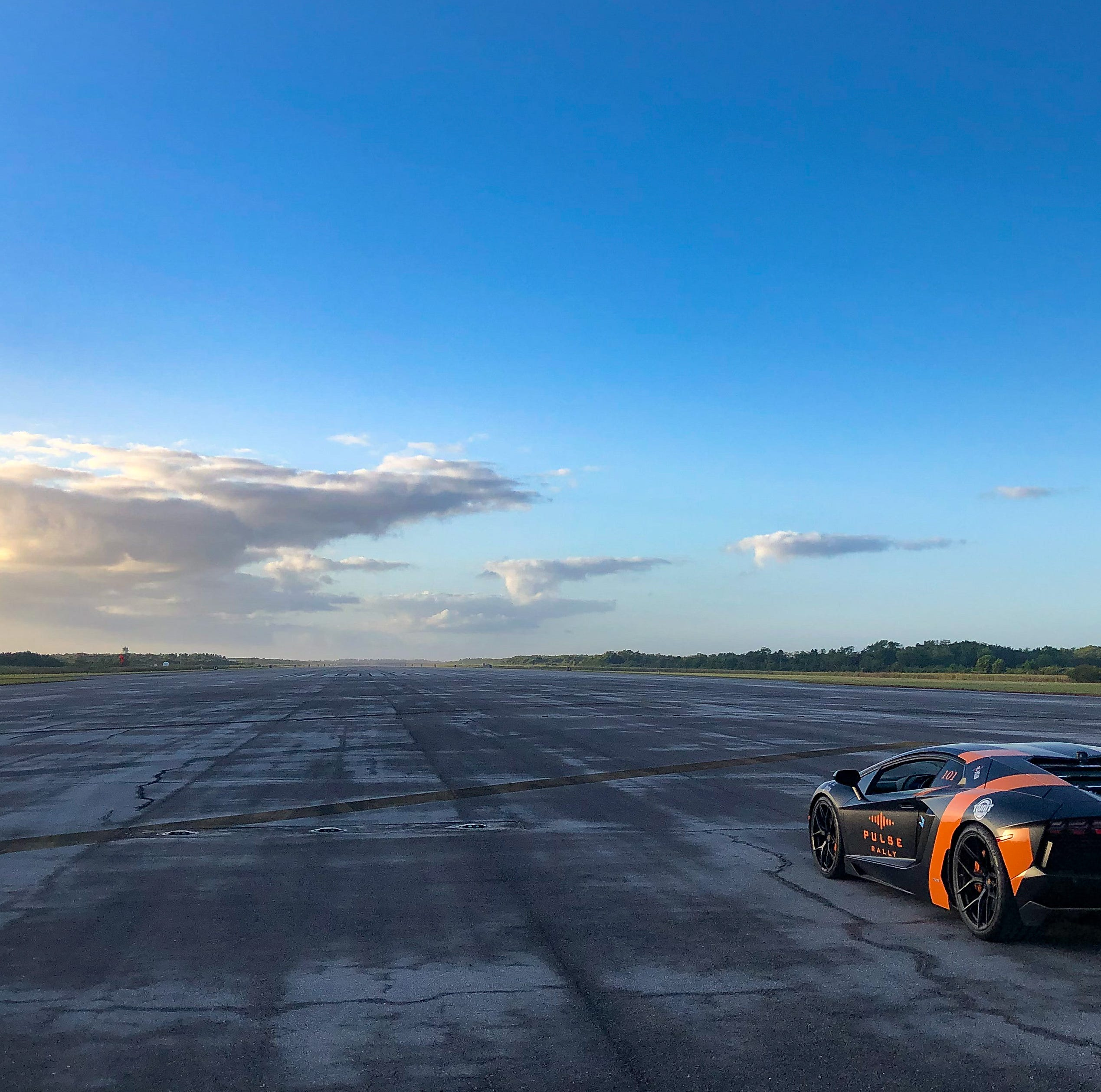 A bond over burnt rubber: Father and son speed test their supercars where space shuttles once landed