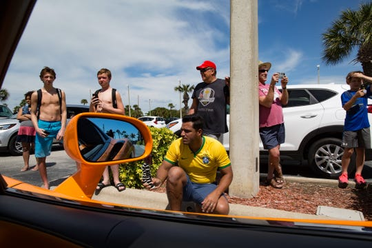 """Driving one of these supercars is like ... when people see this it's like they see Elvis ..."" says Craig Allard, one of the owners of Pulse Rally in March 2019. With their bright colors and loud engine noise, these supercars attracted attention everywhere they went, including the parking lot of a hotel on the east coast of Florida."