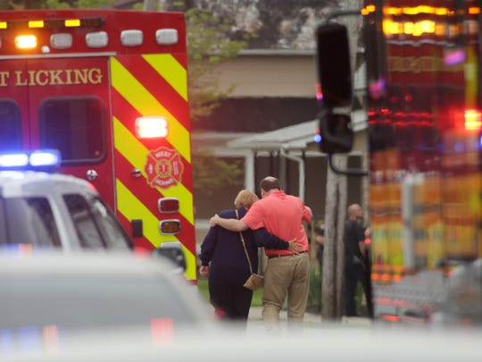 A Newark Advocate file photo shows Mark Weiner, a Licking County victim advocate, on the scene of a shooting at Pine Kirk Care Center on Main Street in Kirkersville, after a gunman killed Kirkersville Police Chief Steven Eric DiSario, two employees and self in May 2017.
