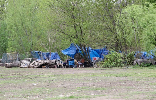 Blue tarps protect mattresses that homeless people sleep on at Dundee Island Park, in Passaic. Monday, April, 22, 2019