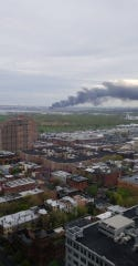 A plume of smoke coming from a fire at a Jersey City scrap yard as seen from  Hoboken on Thursday, April 25, 2019.