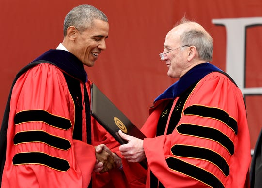 Rutgers University President Robert Barchi gives President Barack Obama his honorary doctorate of law degree at the 250th anniversary Rutgers University commencement. President Obama delivered the commencement address during graduation held at High Point Solutions Stadium on Sunday, May 15, 2016.