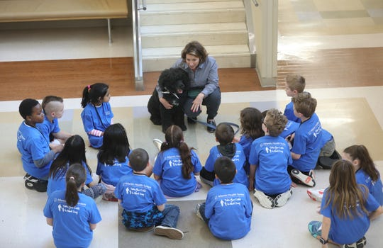 Practice Manager of Emergency Medicine at Morristown Medical Center, Elizabeth Siccone, introduces El Cid, to youngsters during the Bring your Kids to Work program. Thursday, April, 25, 2019