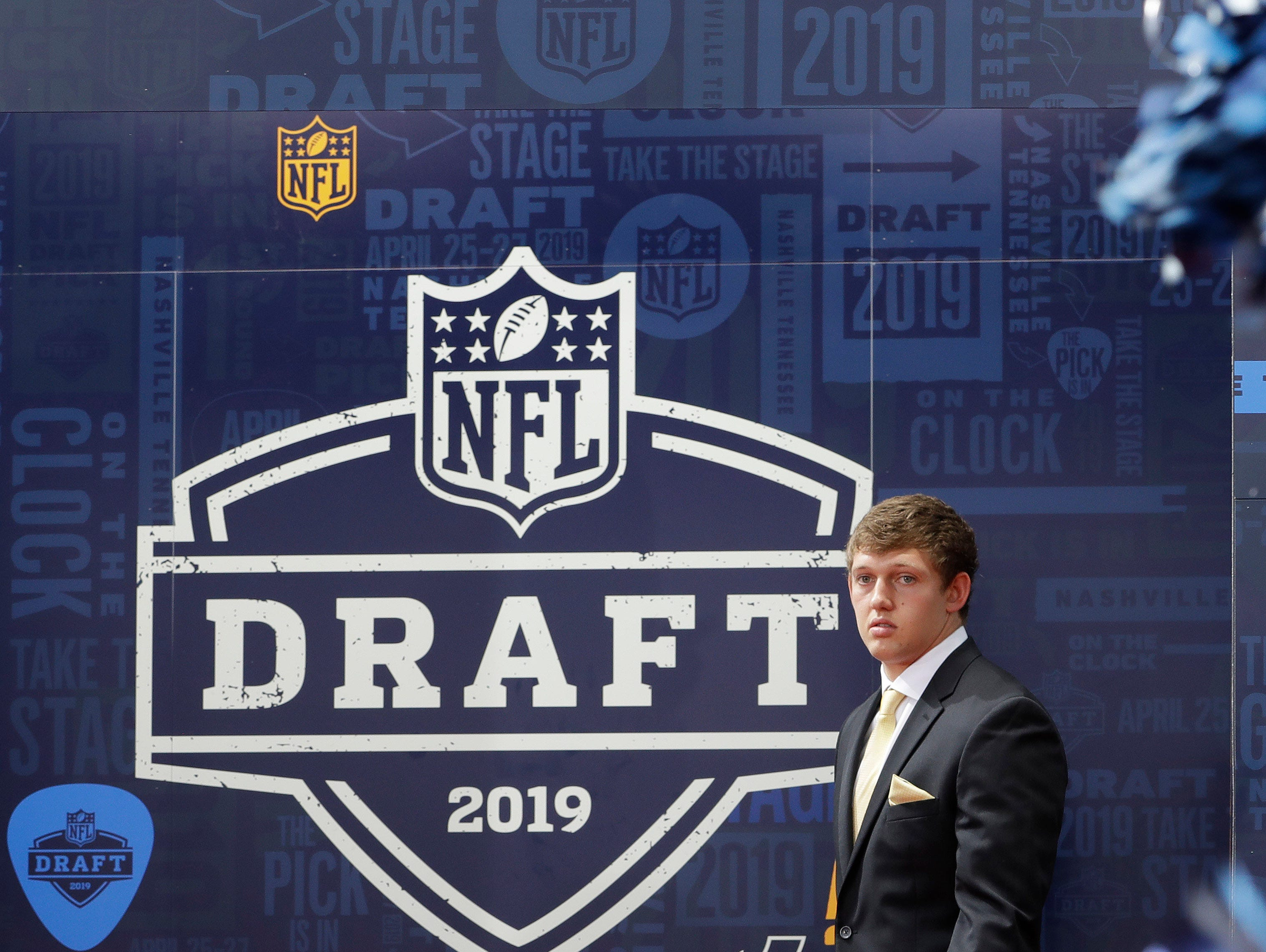 Iowa tight end T.J. Hockenson walks the red carpet ahead of the first round at the NFL football draft, Thursday, April 25, 2019, in Nashville, Tenn. (AP Photo/Steve Helber)