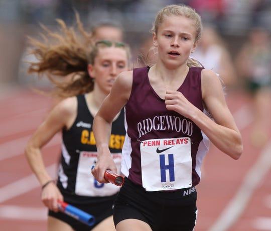 Camryn Wennersten  of Ridgewood runs the Distance Medley.