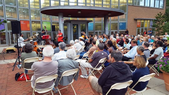 Pheeroan akLaff, who runs Seed Artists with Chris Napierala, plays percussion with Oscar Noriega on reeds and Trevor Dunn on bass in front of the Montclair Public Library in July, 2017.