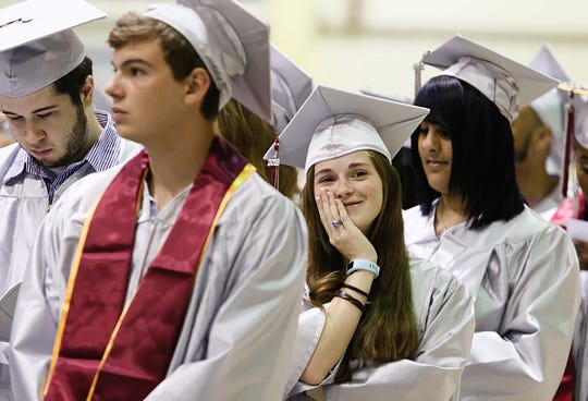 Jessica Lee Farr spots her family during the Count College of Morris graduation ceremony at Mennen Arena in Morris Township on May 25, 2018.